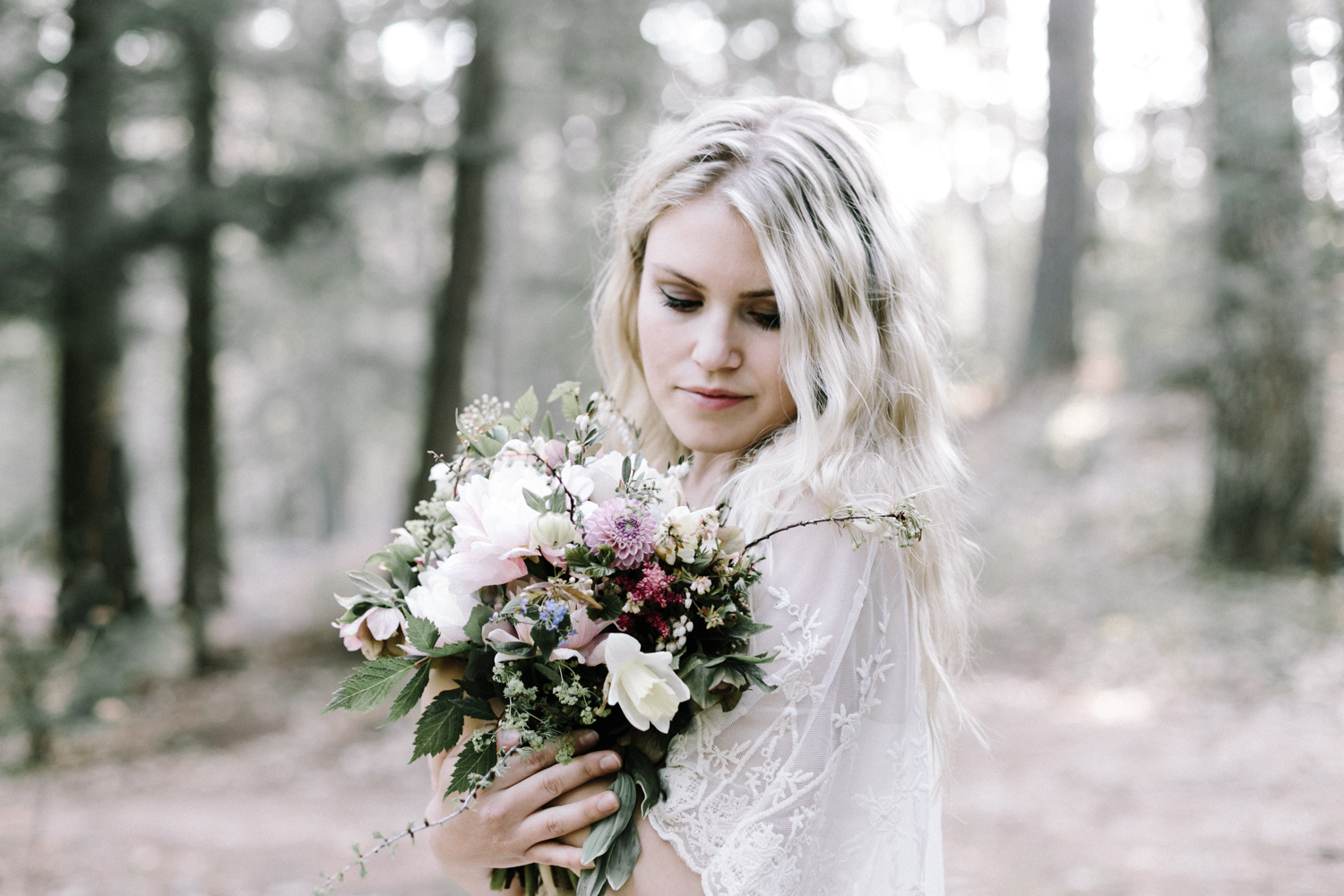 A bride carries her beautiful foraged Michigan bouquet in the U.P.