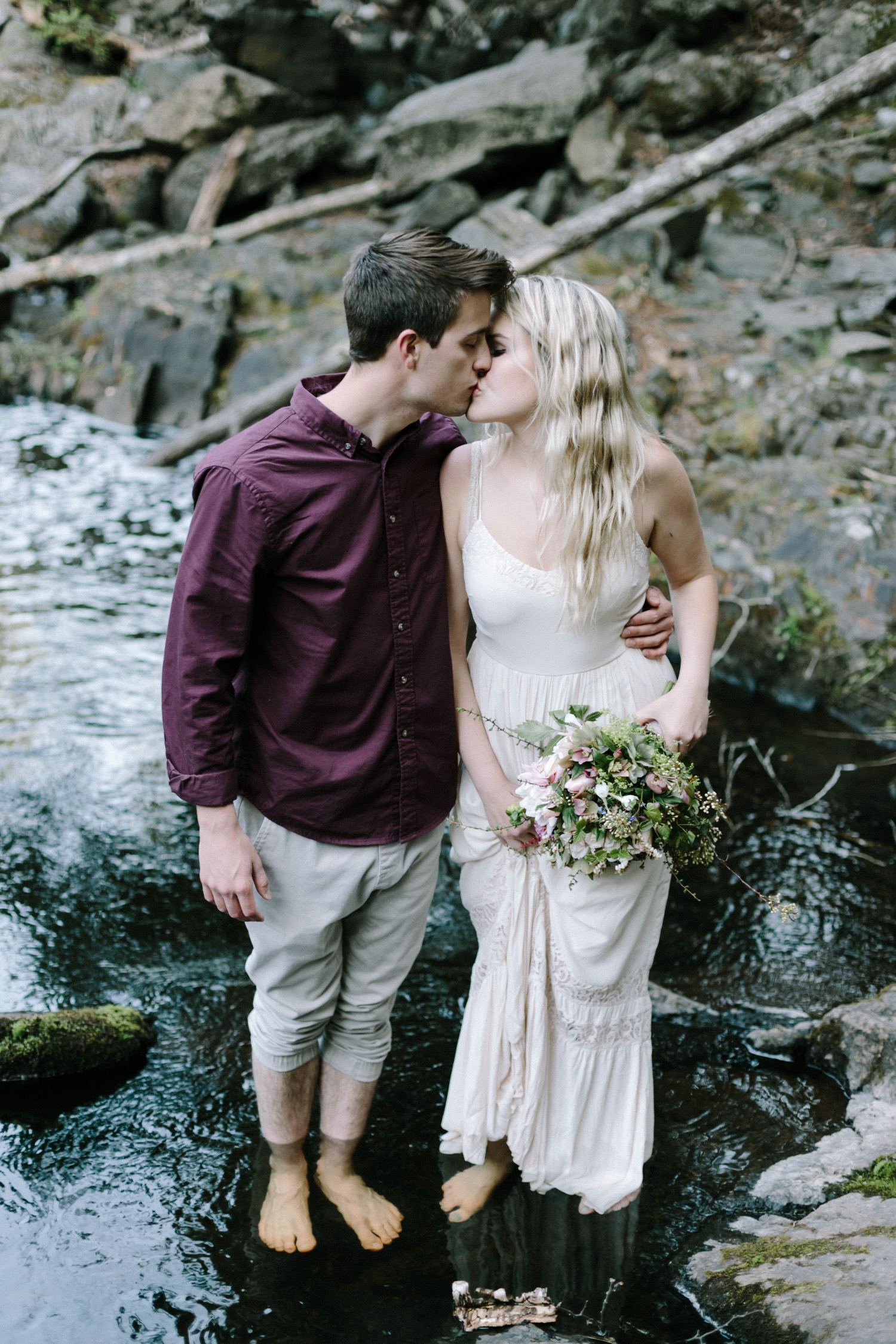 a couple kissing at their Marquette, Michigan engagement session