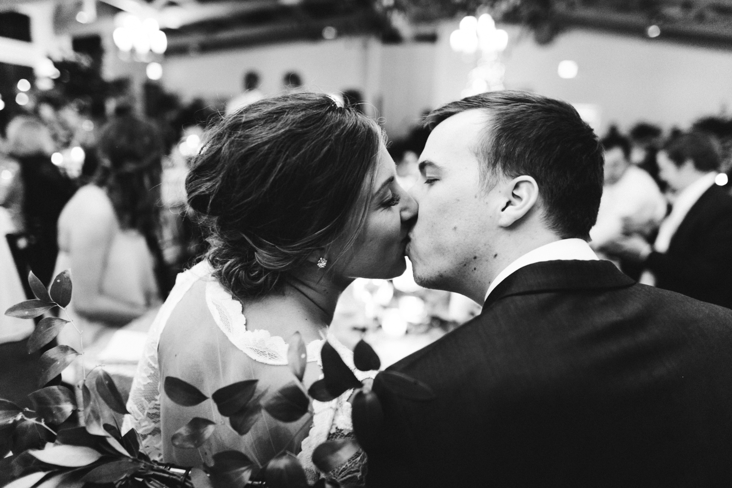 A couple kisses at their wedding reception at Boatwerks in Holland