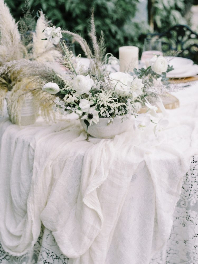 an organic, neutral floral centerpiece on a wedding reception table at a Greencrest Manor in Battle Creek, Michigan