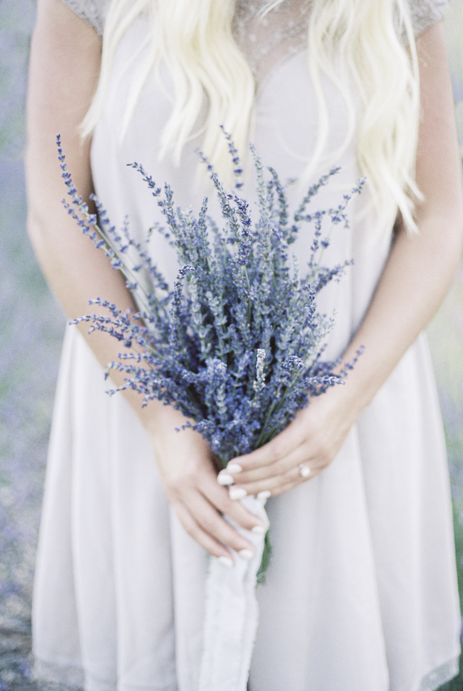 Michigan bride to be holding a bouquet of fresh lavender