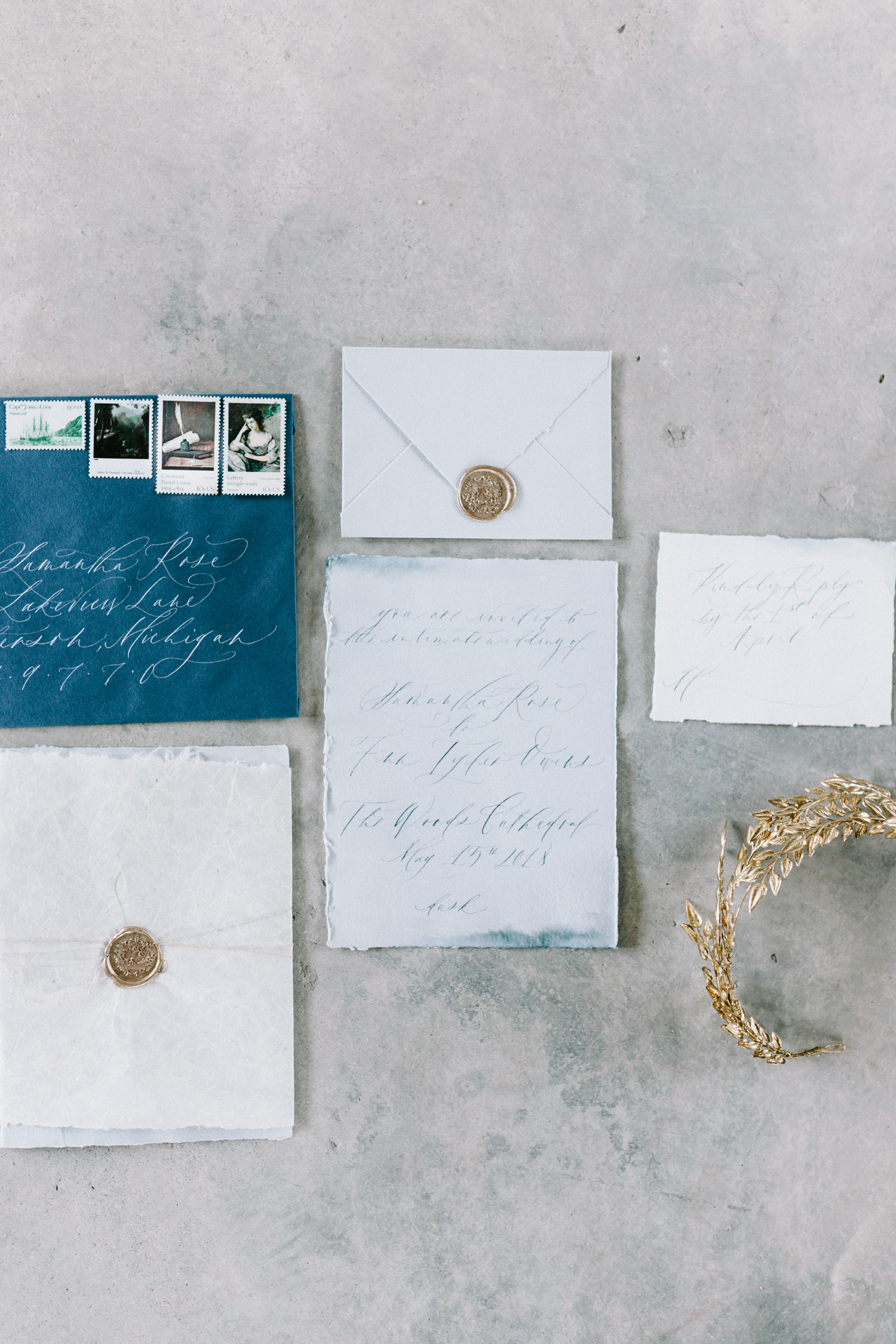 A handmade paper and calligraphy invitation suite for a destination wedding in an abandoned cathedral
