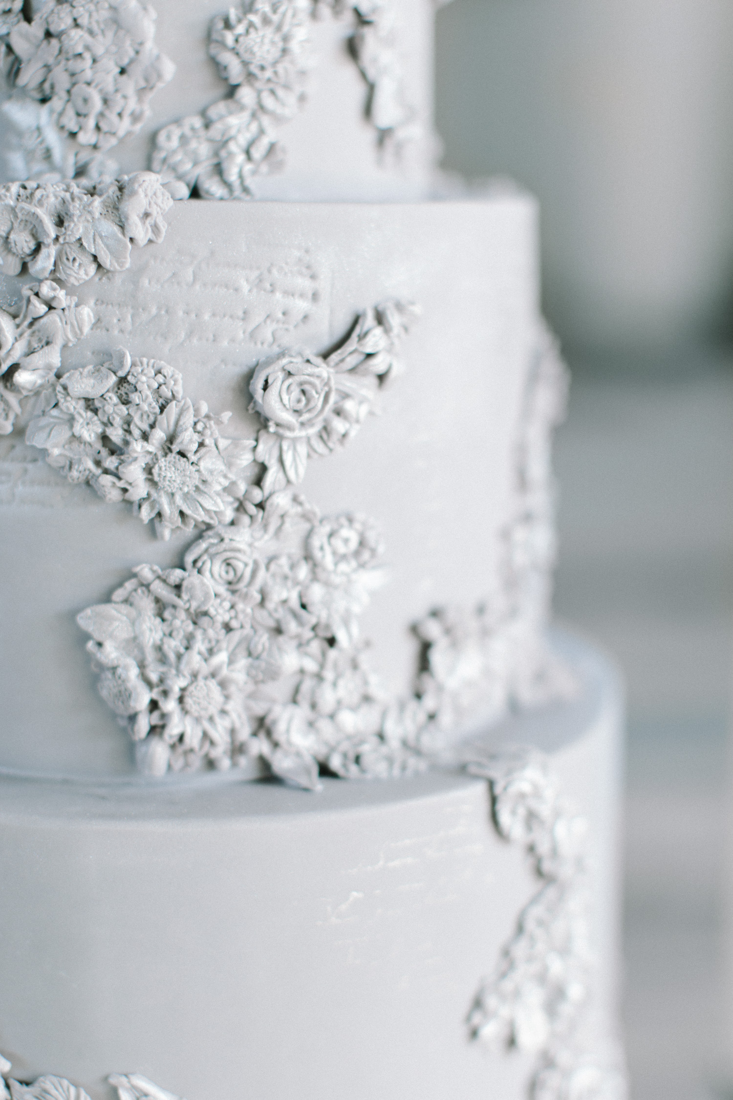 A beautiful silver blue bas relief wedding cake for a Mediterranean destination wedding