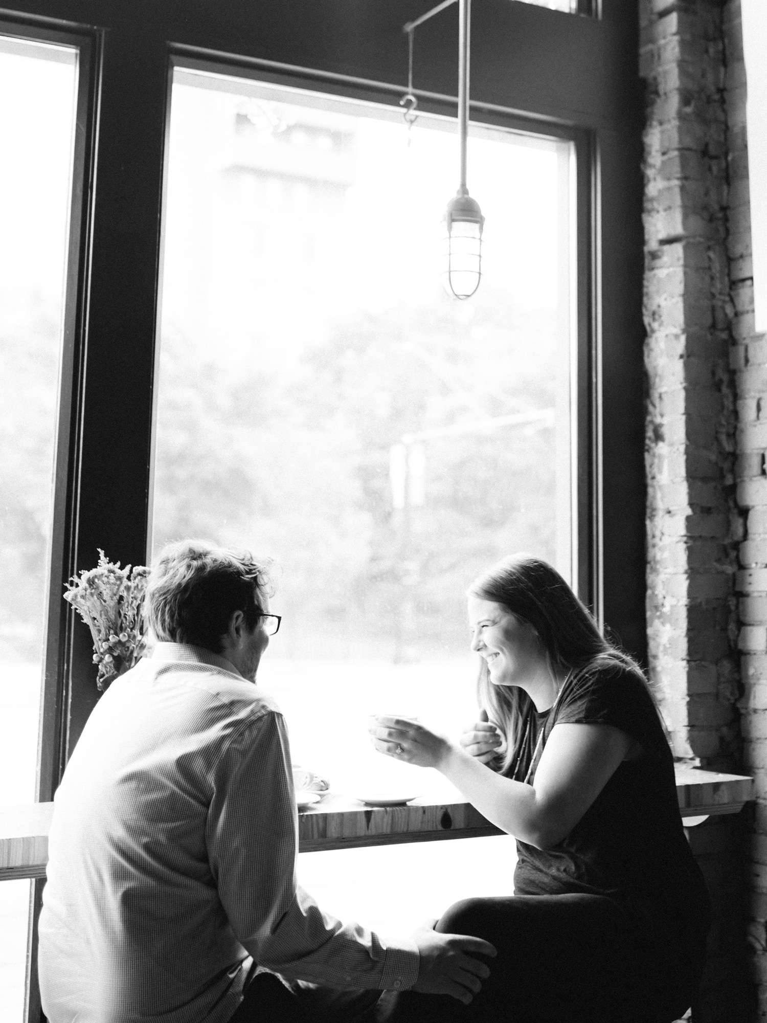 An engaged couple shares coffee at Great Lakes in Detroit