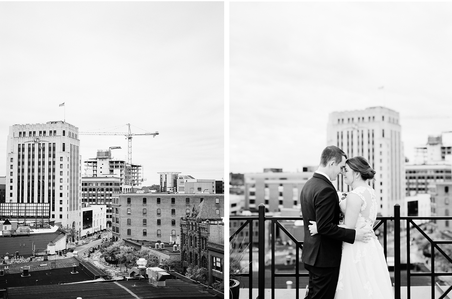 A couple embraces against the skyline of downtown Kalamazoo after their rooftop wedding