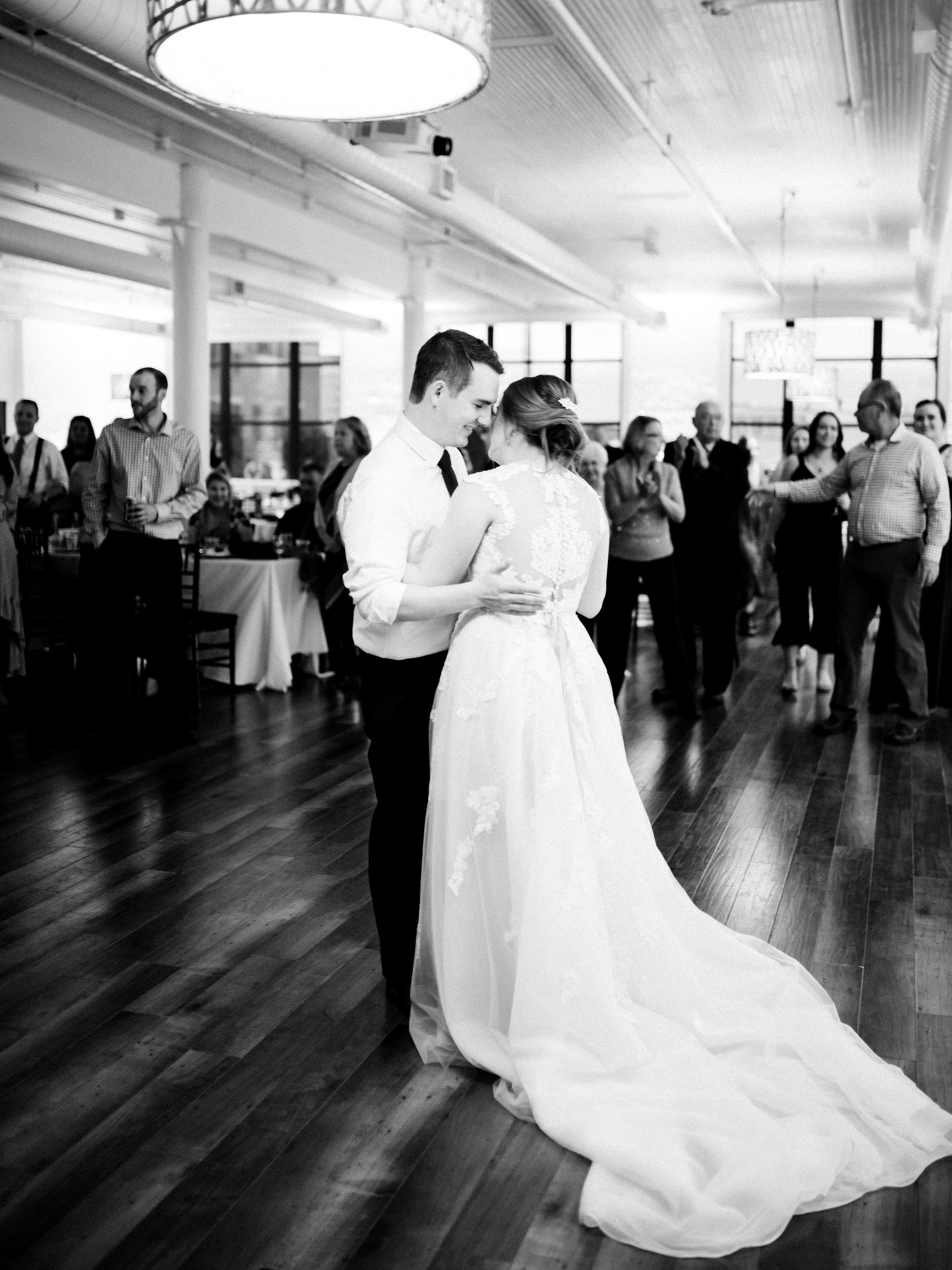 A couple shares their first dance at their wedding in downtown Kalamazoo
