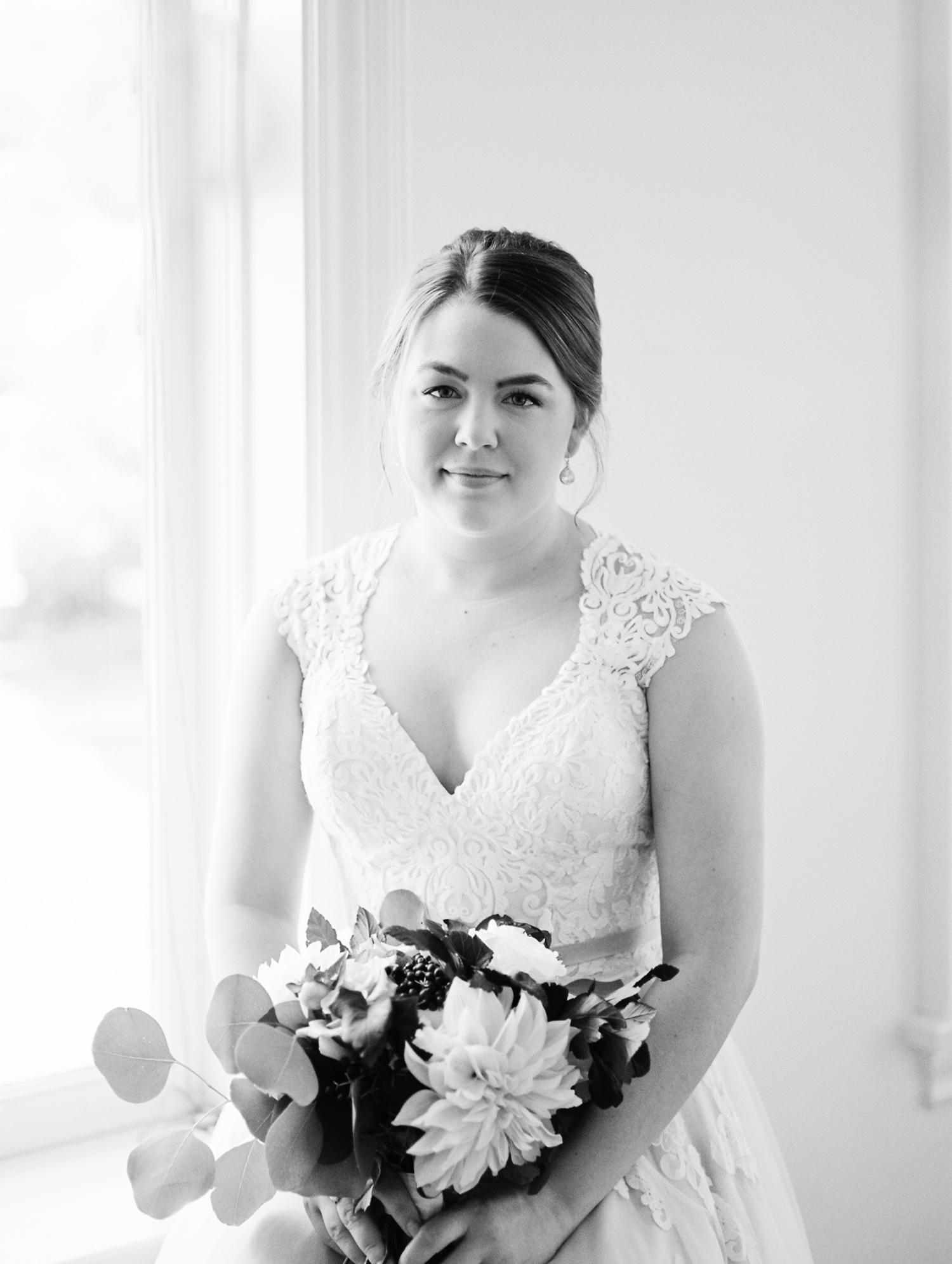 a beautiful bride in a lace gown in Kalamazoo, Michigan