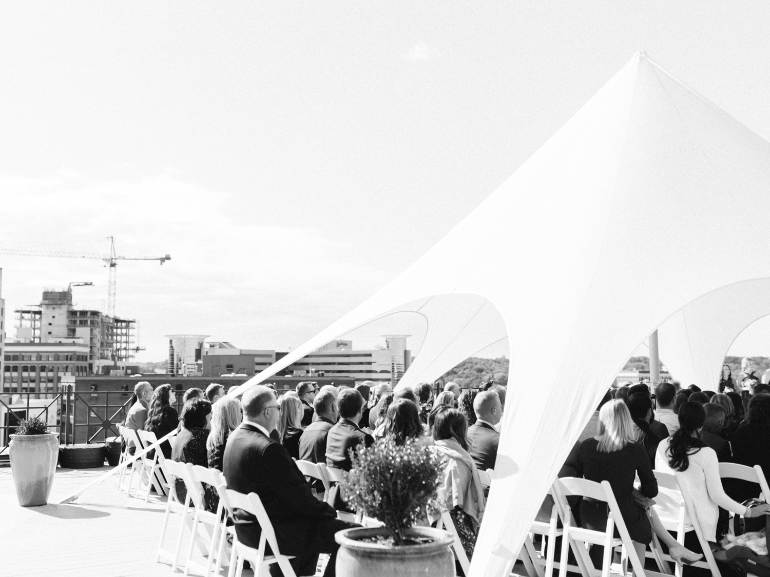 Guests seated under a tent on the rooftop skydeck of Loft 310