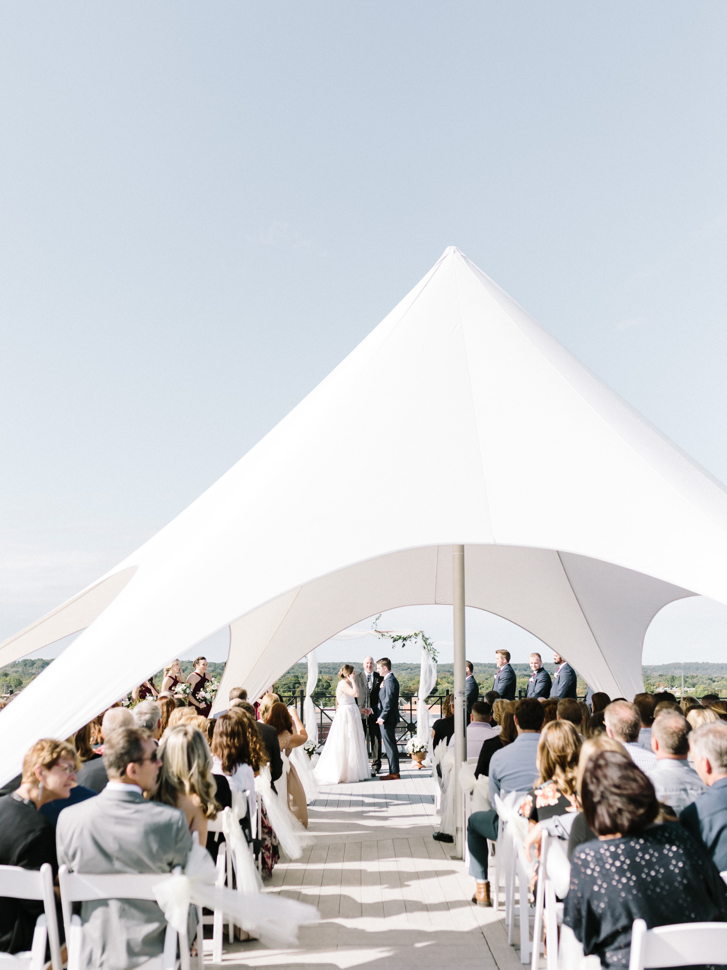 A tented wedding ceremony on the rooftop of Loft 310 in downtown Kalamazoo