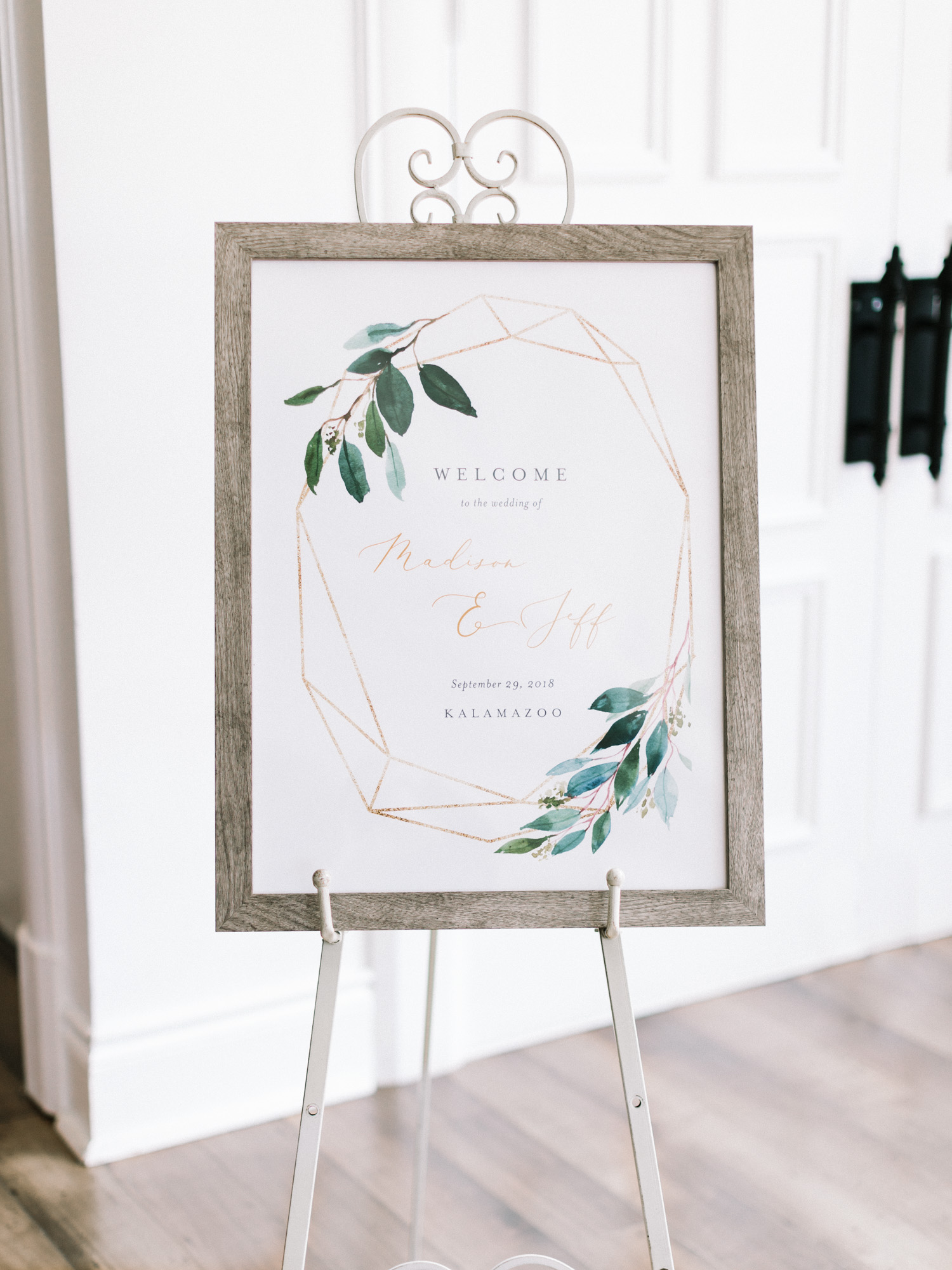 A welcome sign in the Loft 310 wedding reception space
