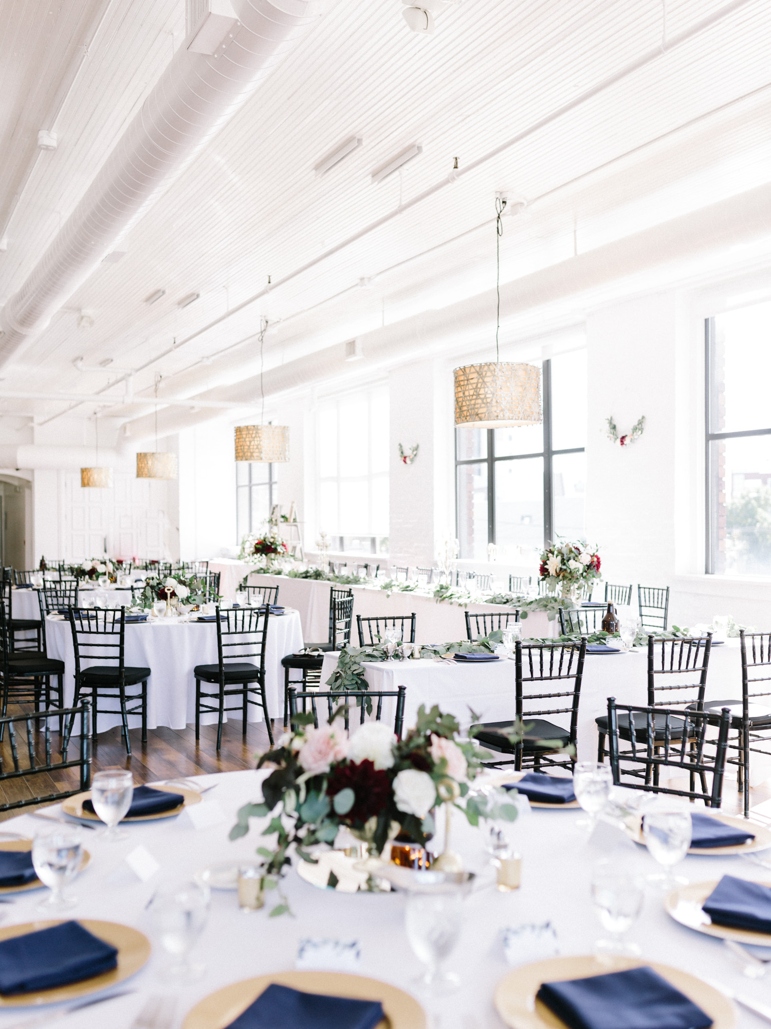 Reception tables, centerpieces, and decor at Loft 310 in Kalamazoo, Michigan