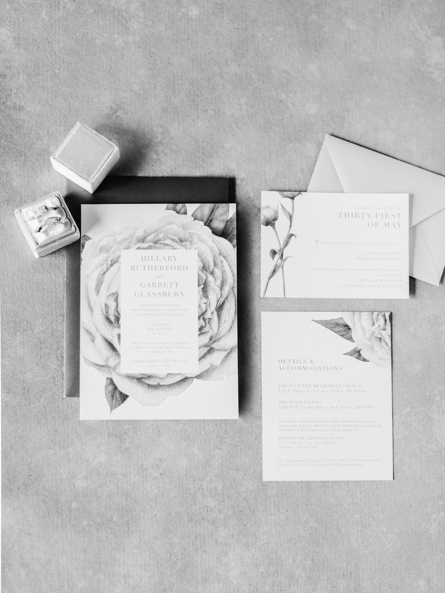 A floral wedding invitation suite rests on a painterly background in Ann Arbor, Michigan