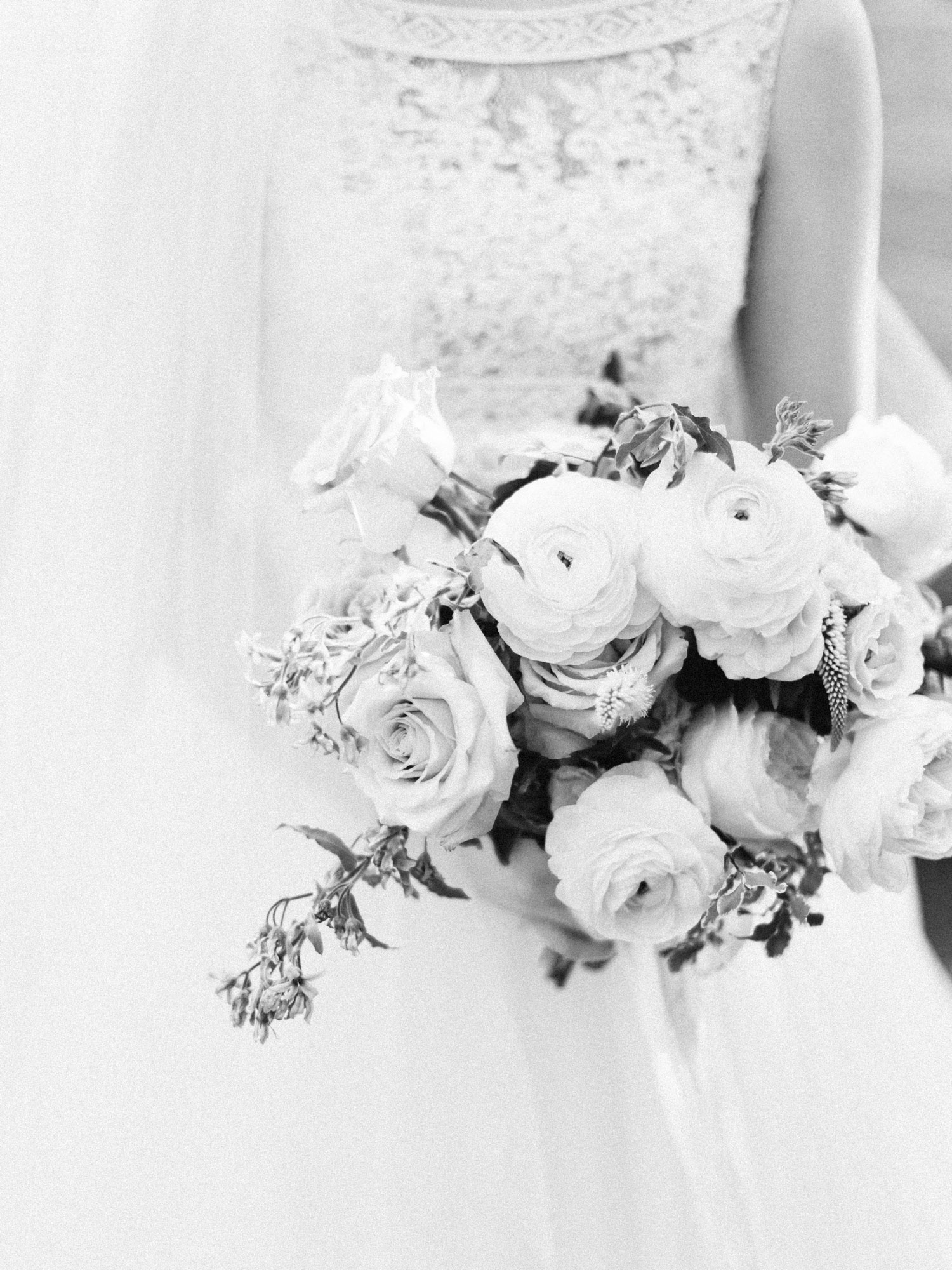 A timeless wedding bouquet captured in black and white outside an Ann Arbor church