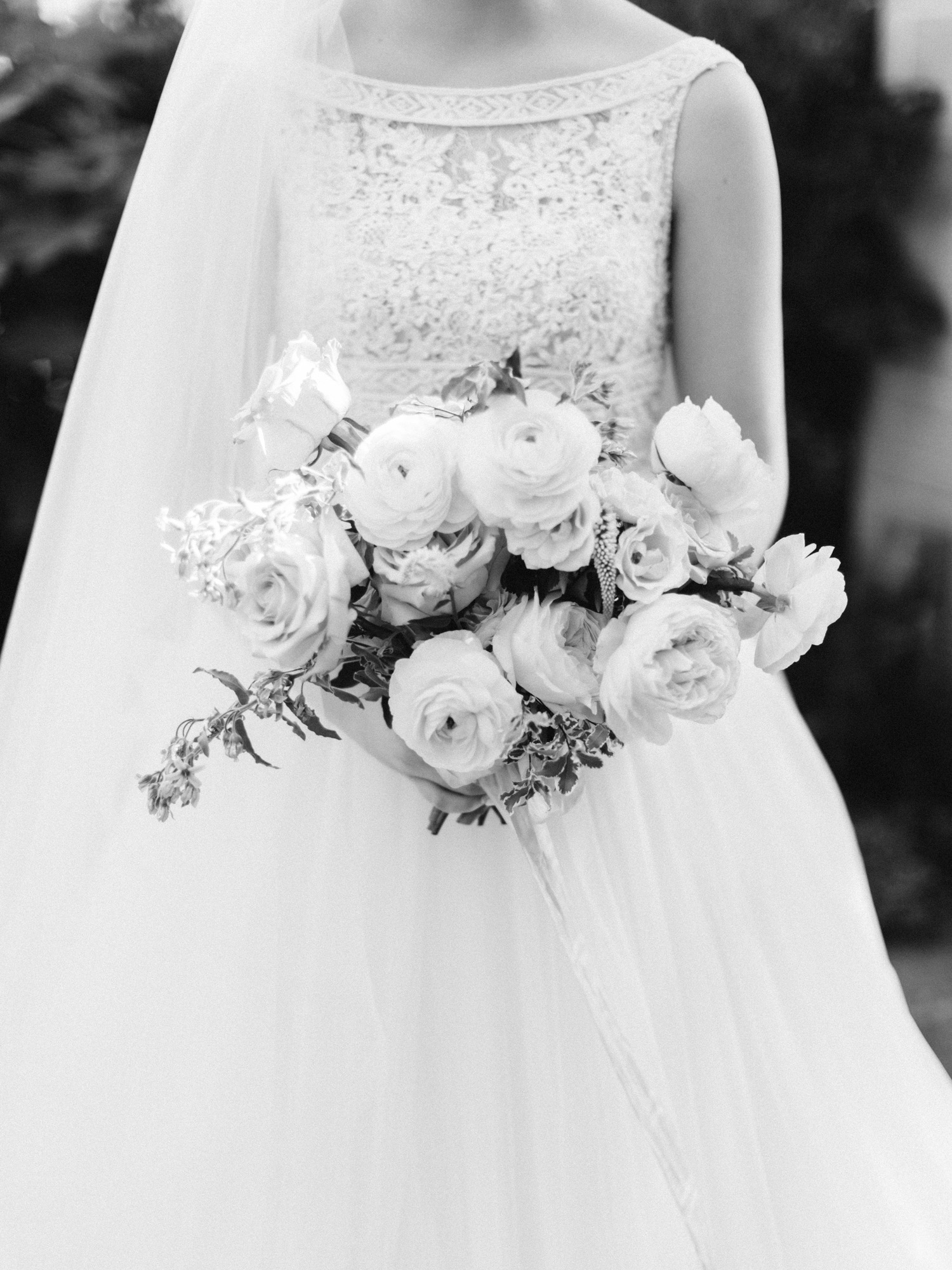 A bridal bouquet has a timeless look captured on black and white film by Christina Harrison