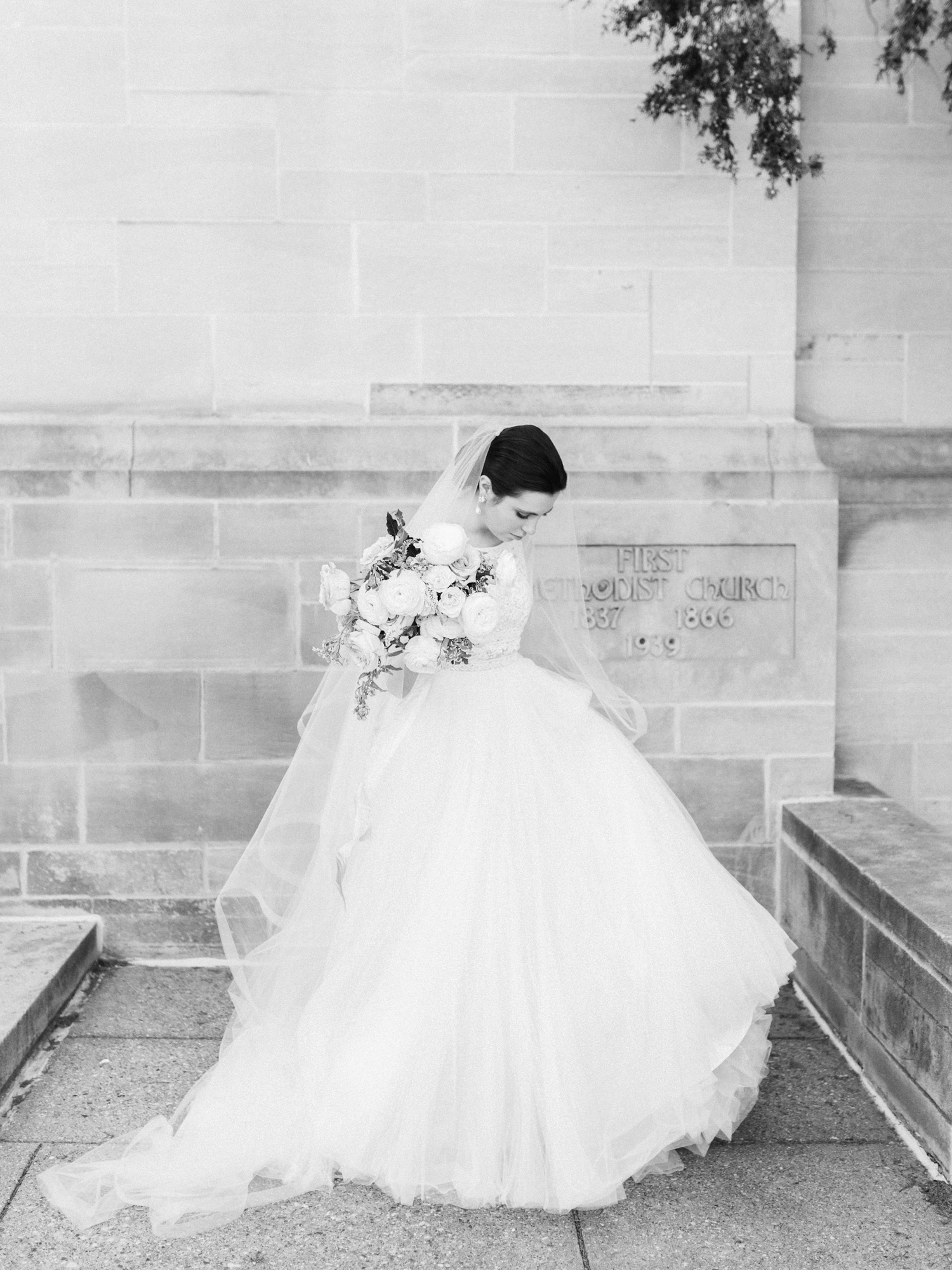 A bride outside her Ann Arbor wedding venue, captured by wedding photographer Christina Harrison