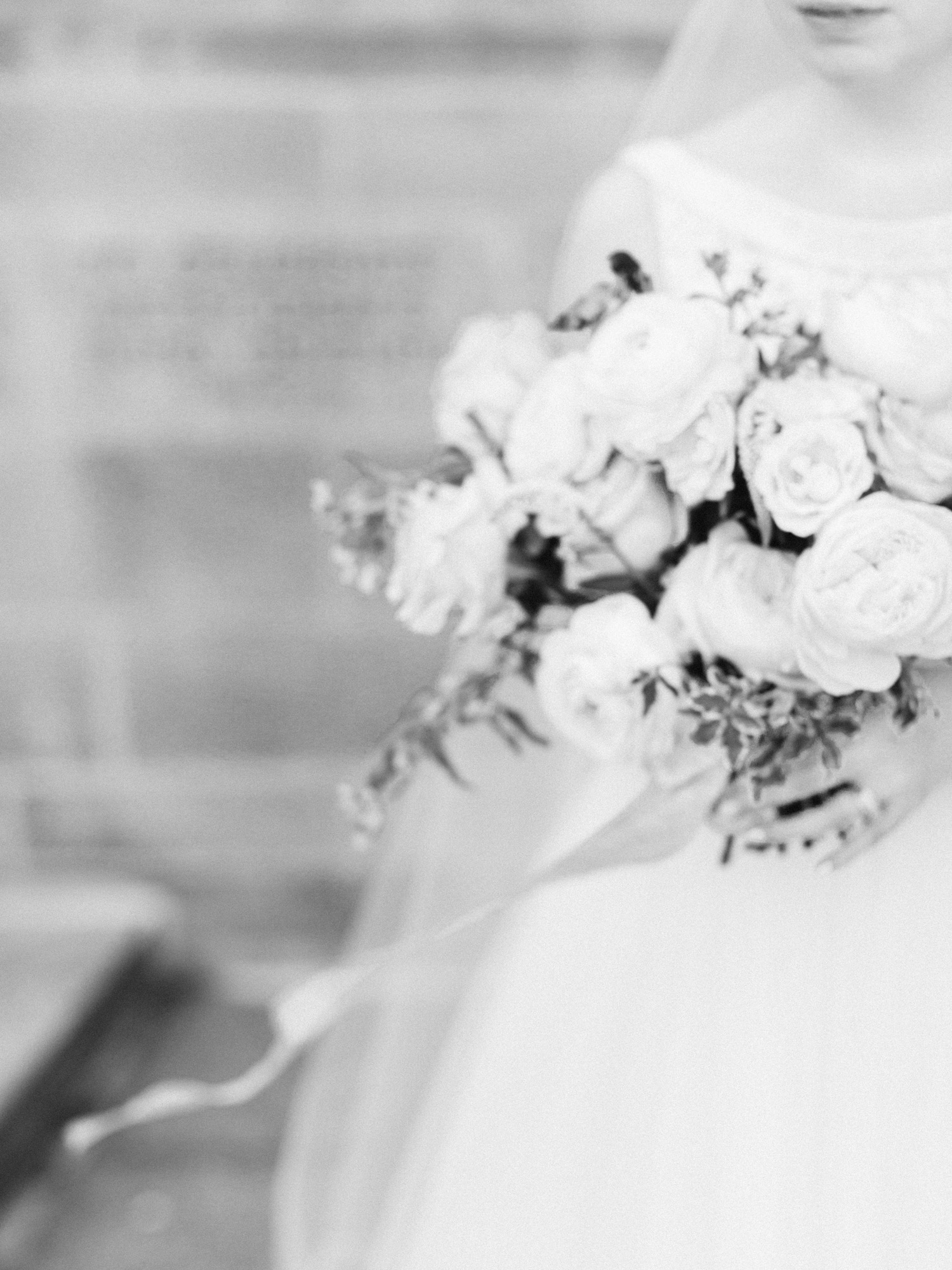 Wind blows the trailing silk ribbon in a bridal bouquet, captured in soft focus