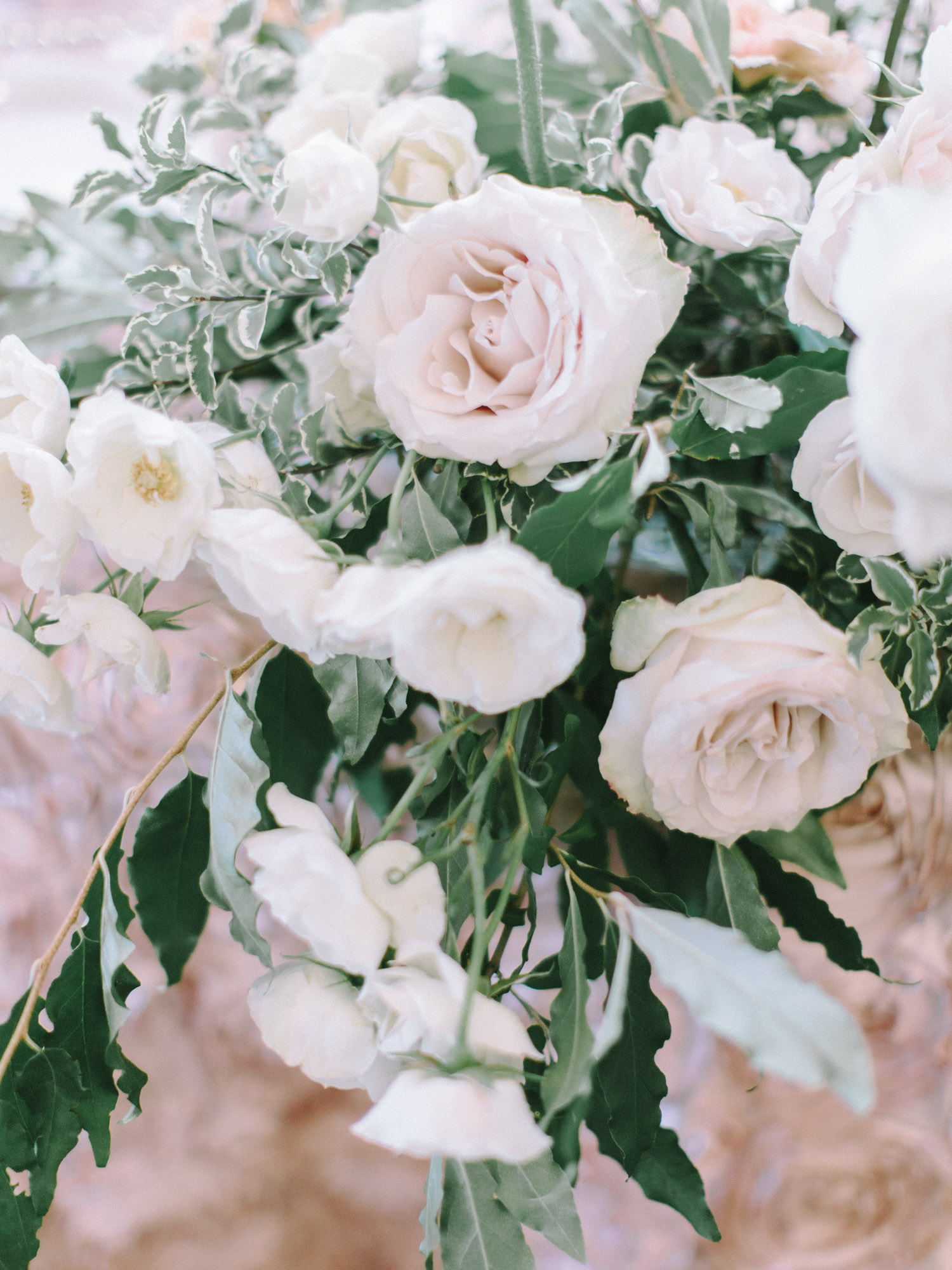 Blush garden roses and greenery make for romantic sweetheart table decor at a wedding venue in Ann Arbor, Michigan
