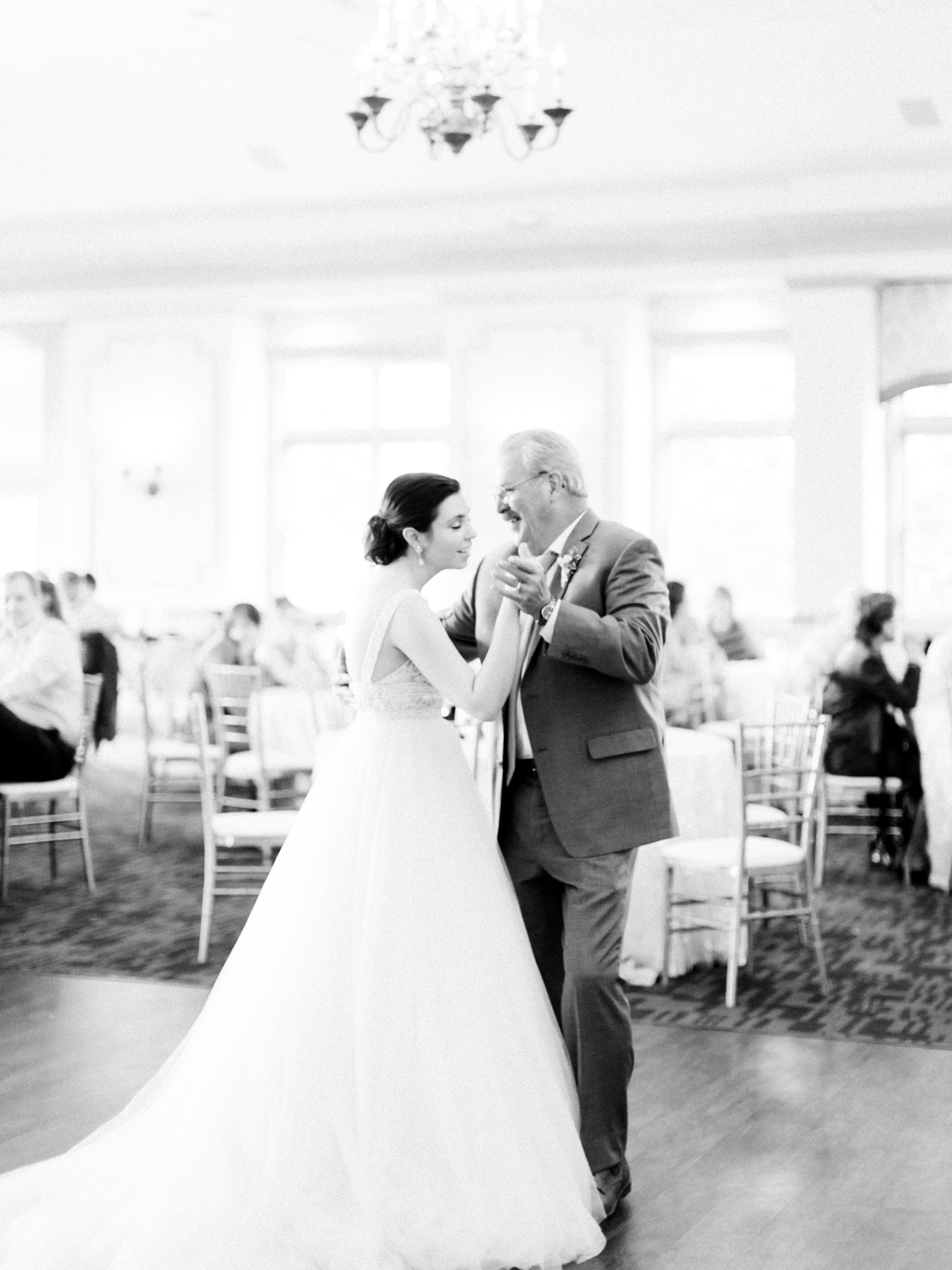 A bride shares a dance with her father at her wedding at The Polo Fields in Ann Arbor