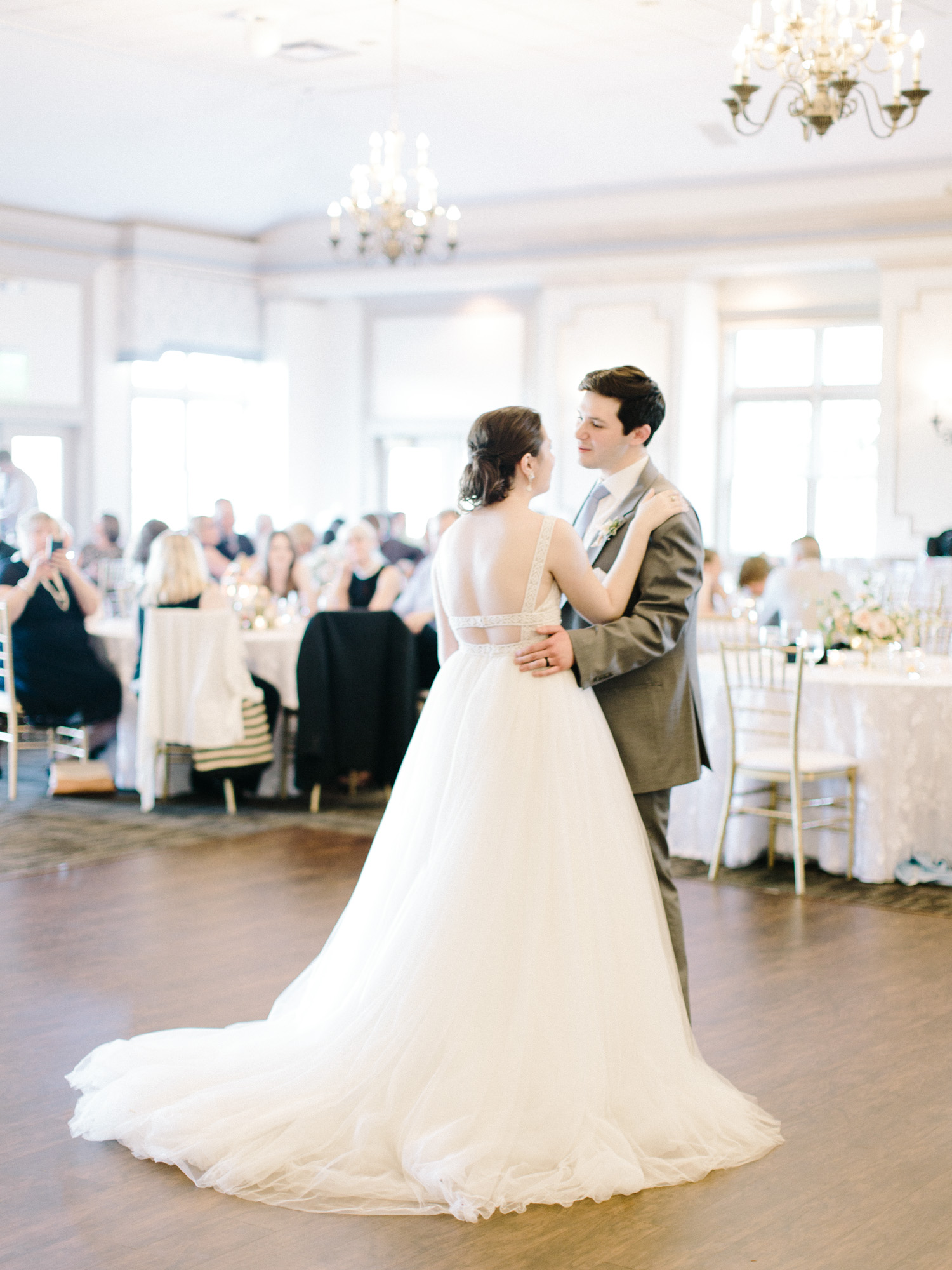 A bride and groom share their first dance at The Polo Fields