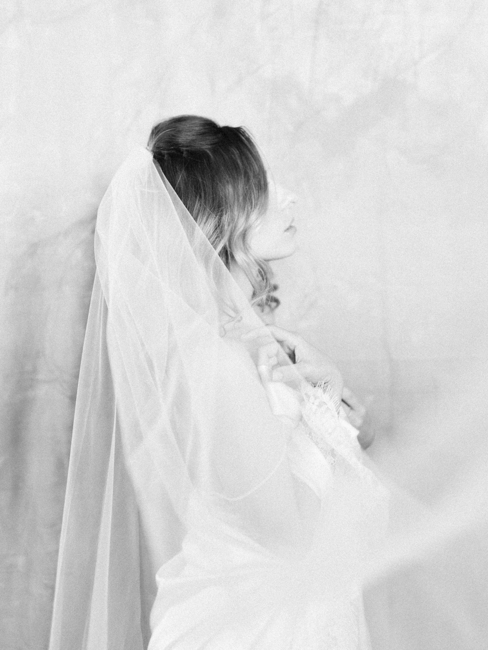 A bride in Girl and A Serious Dream veil and lingerie in dreamy black and white