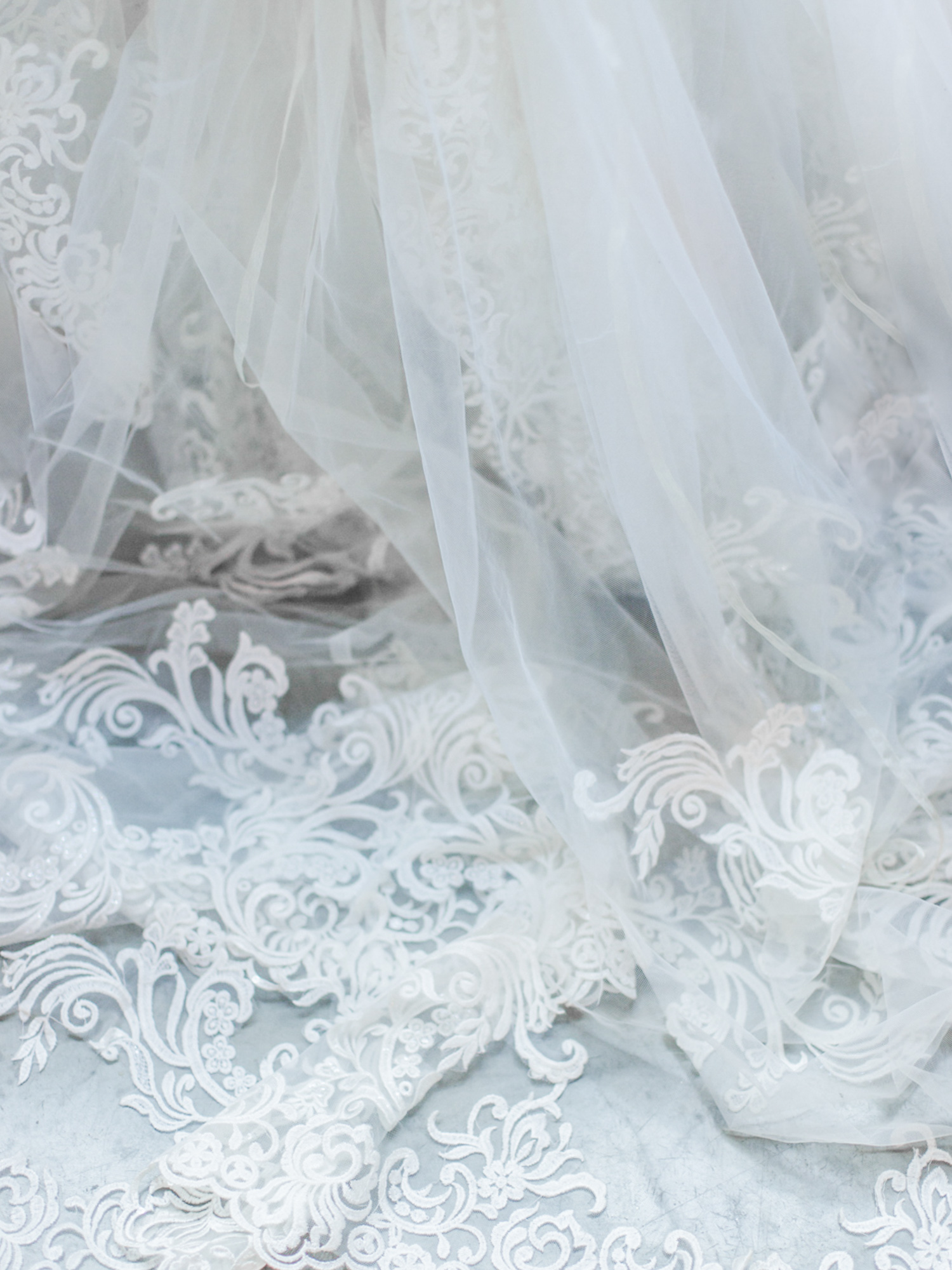 ethereal wedding dress and veil lace puddles on the floor at The Brick in South Bend, Indiana