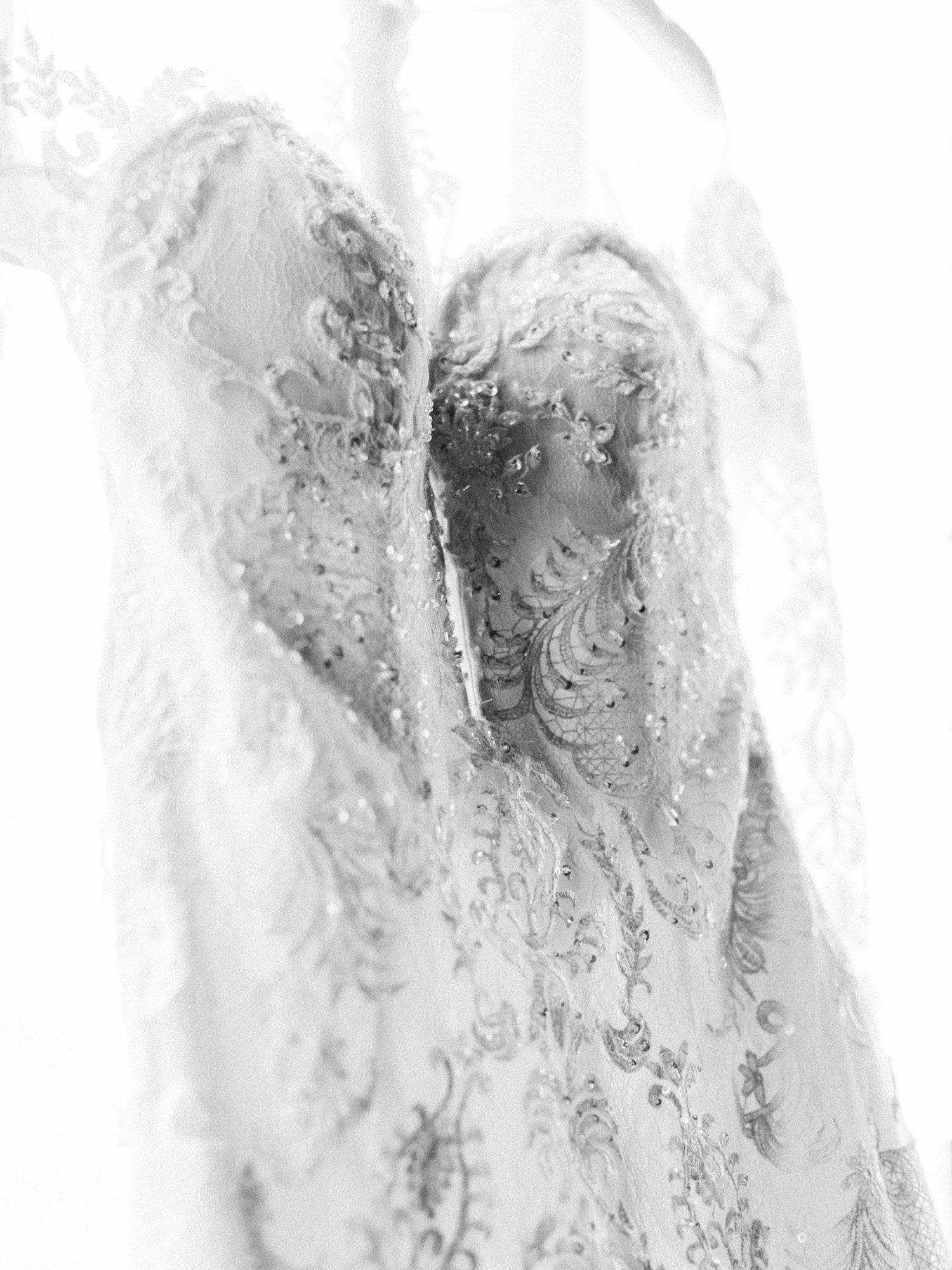 Black and white sparkle and lace detail of a wedding gown in South Bend by Michigan wedding photographer Christina Harrison