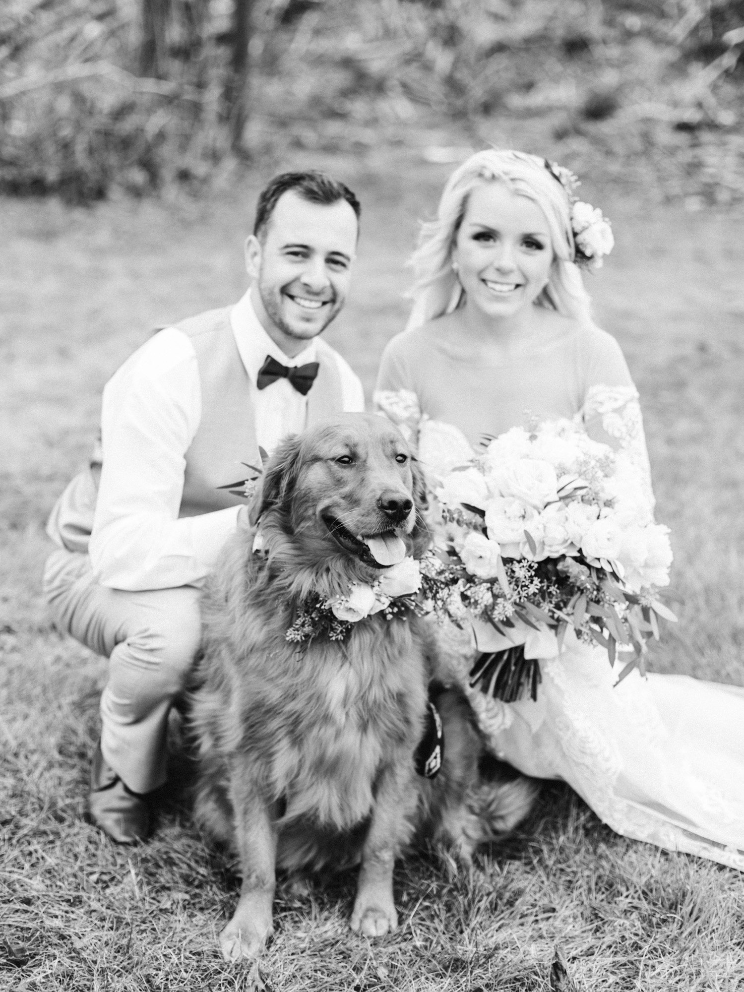 A couple's cute dog wears flowers on their wedding day as they pose for a photo together at The Brick in Indiana