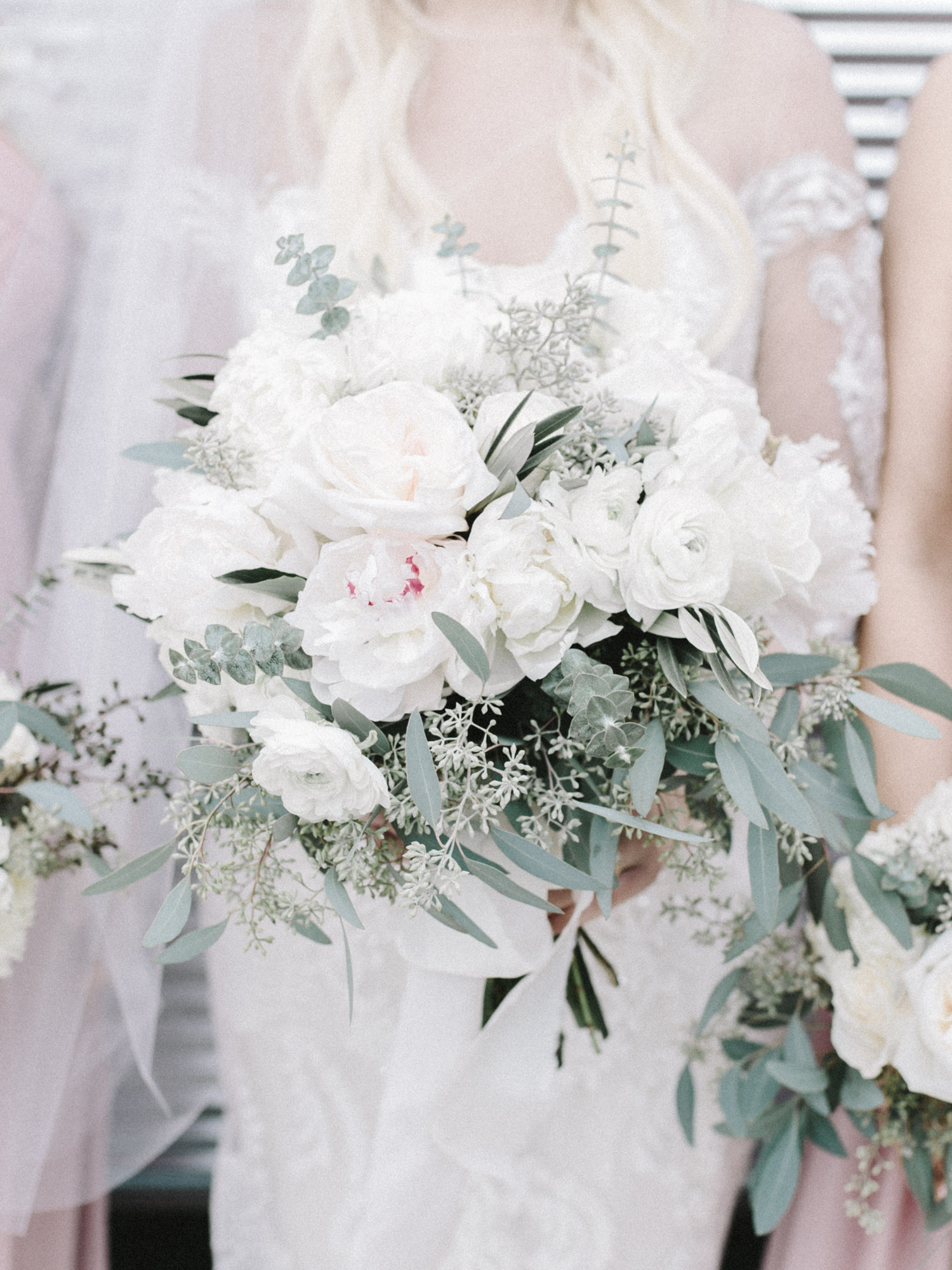 A white, blush, and green bridal bouquet with greenery and seeded eucalyptus at an Indiana wedding