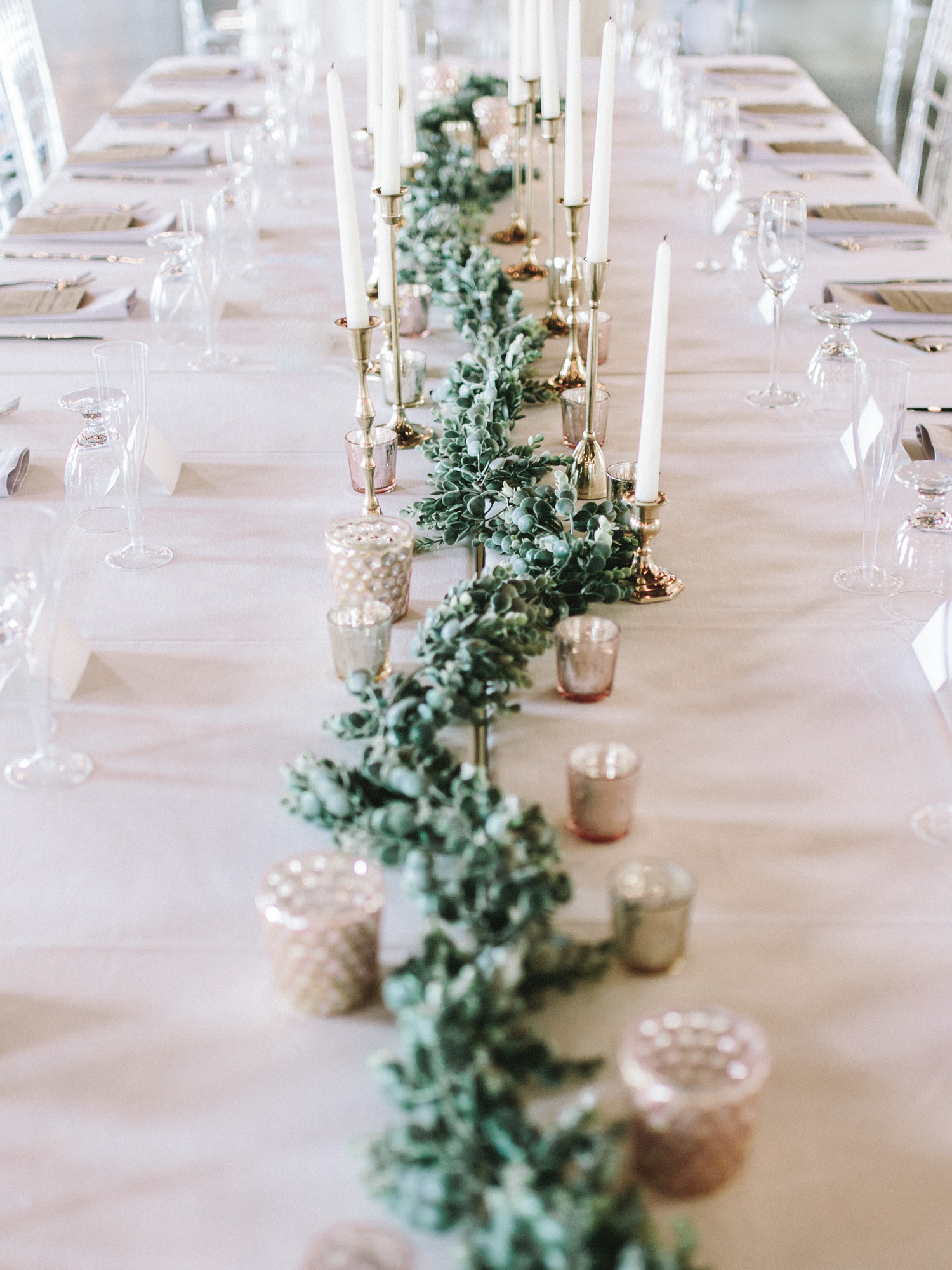 Ethereal and romantic wedding reception table style with ethereal blush and gold candles at a South Bend, Indiana wedding