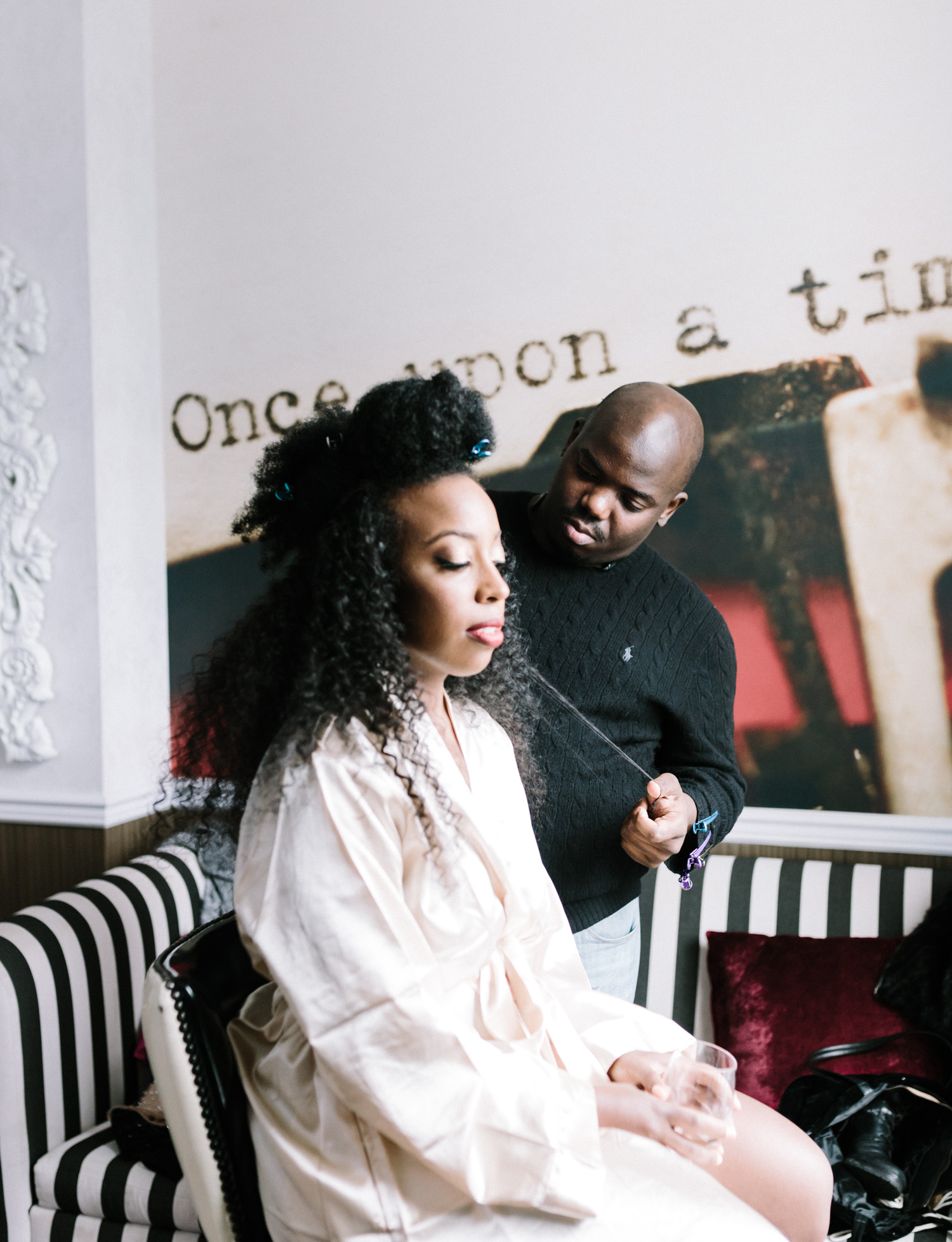On her wedding day, a black bride has her hair done at a Brooklyn, New York hotel
