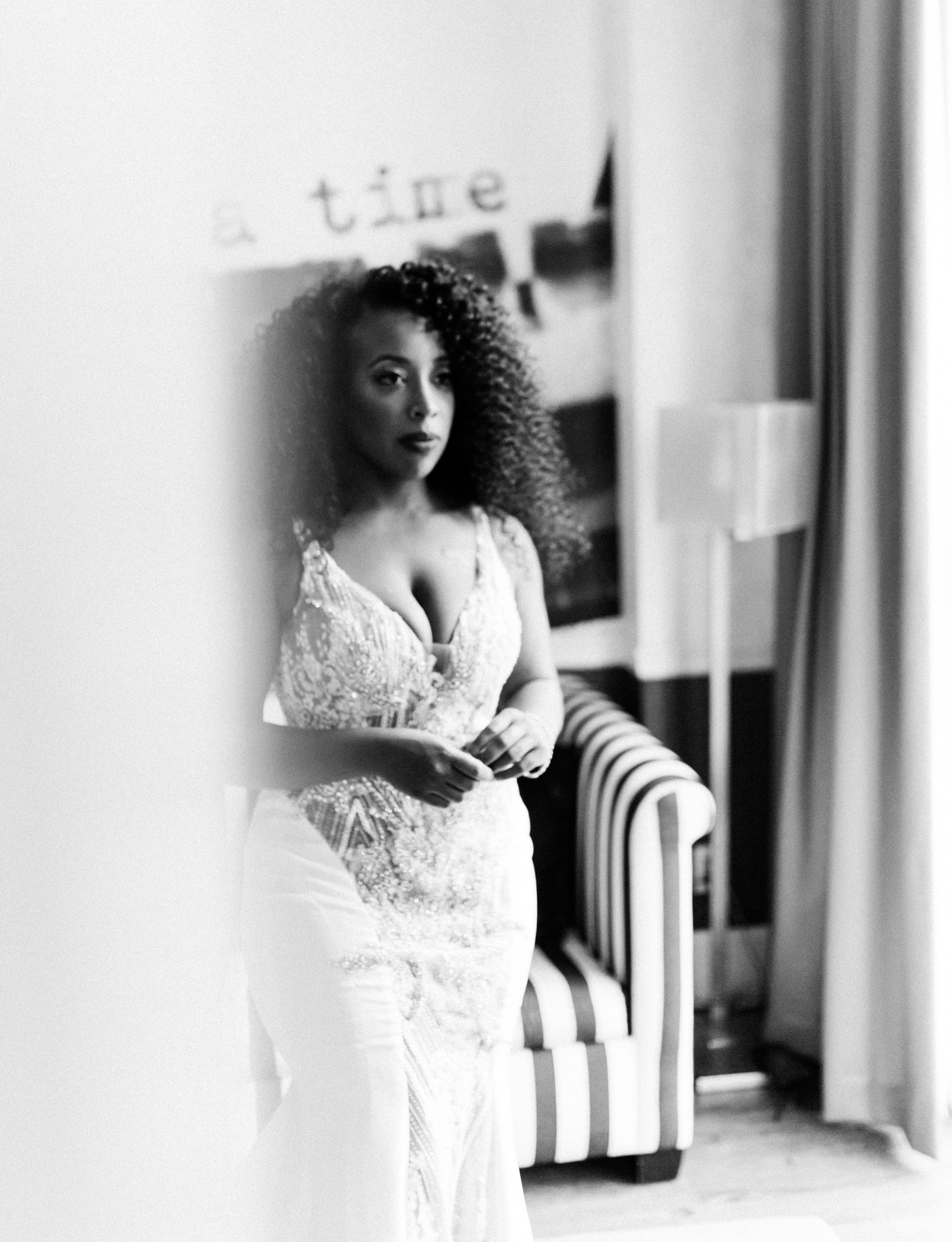 A black bride pauses for a quiet moment in a Brooklyn hotel room before her same sex Brooklyn Winery wedding