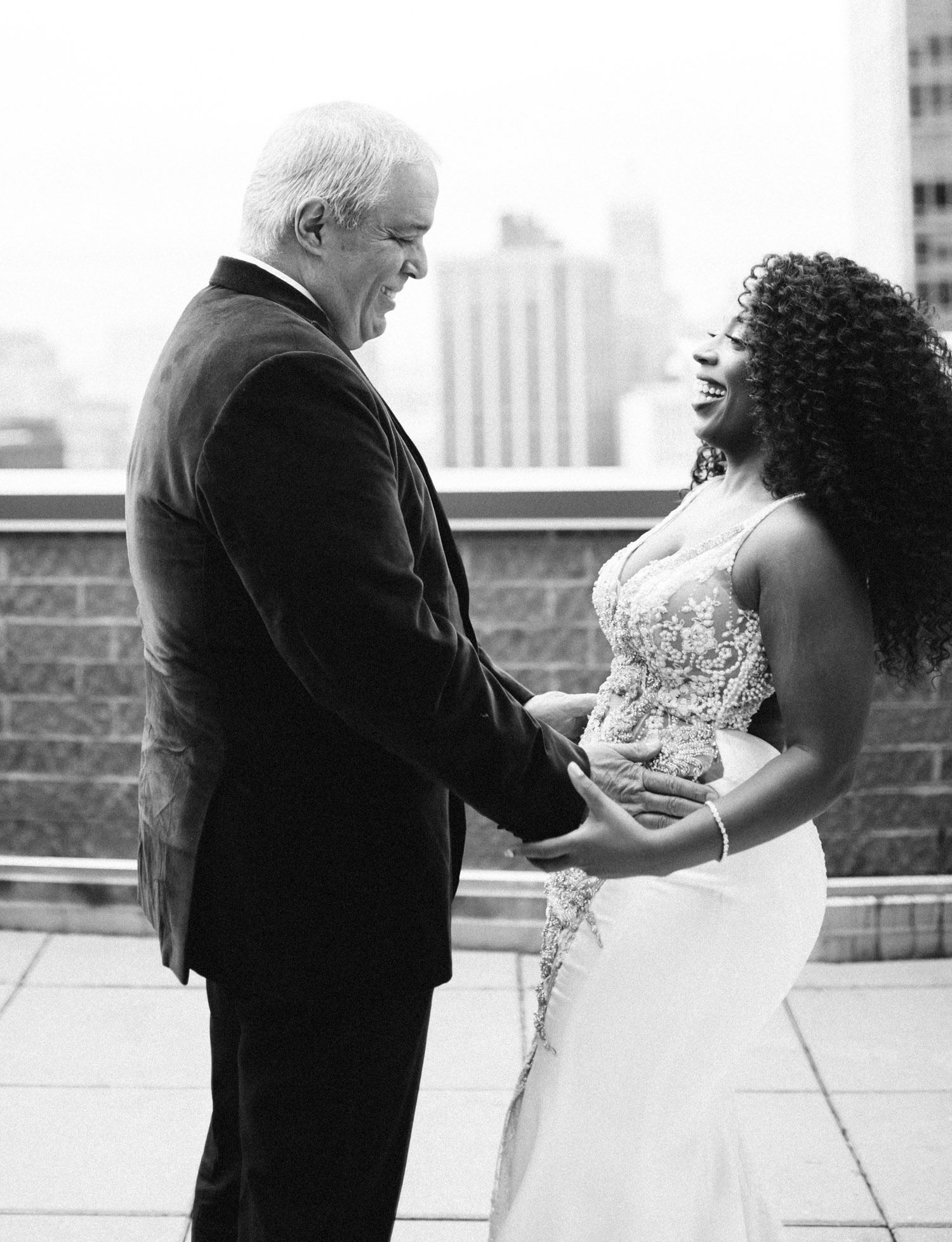 A bride and her father see each other for the first time on her wedding day on a rooftop in Brooklyn, New York
