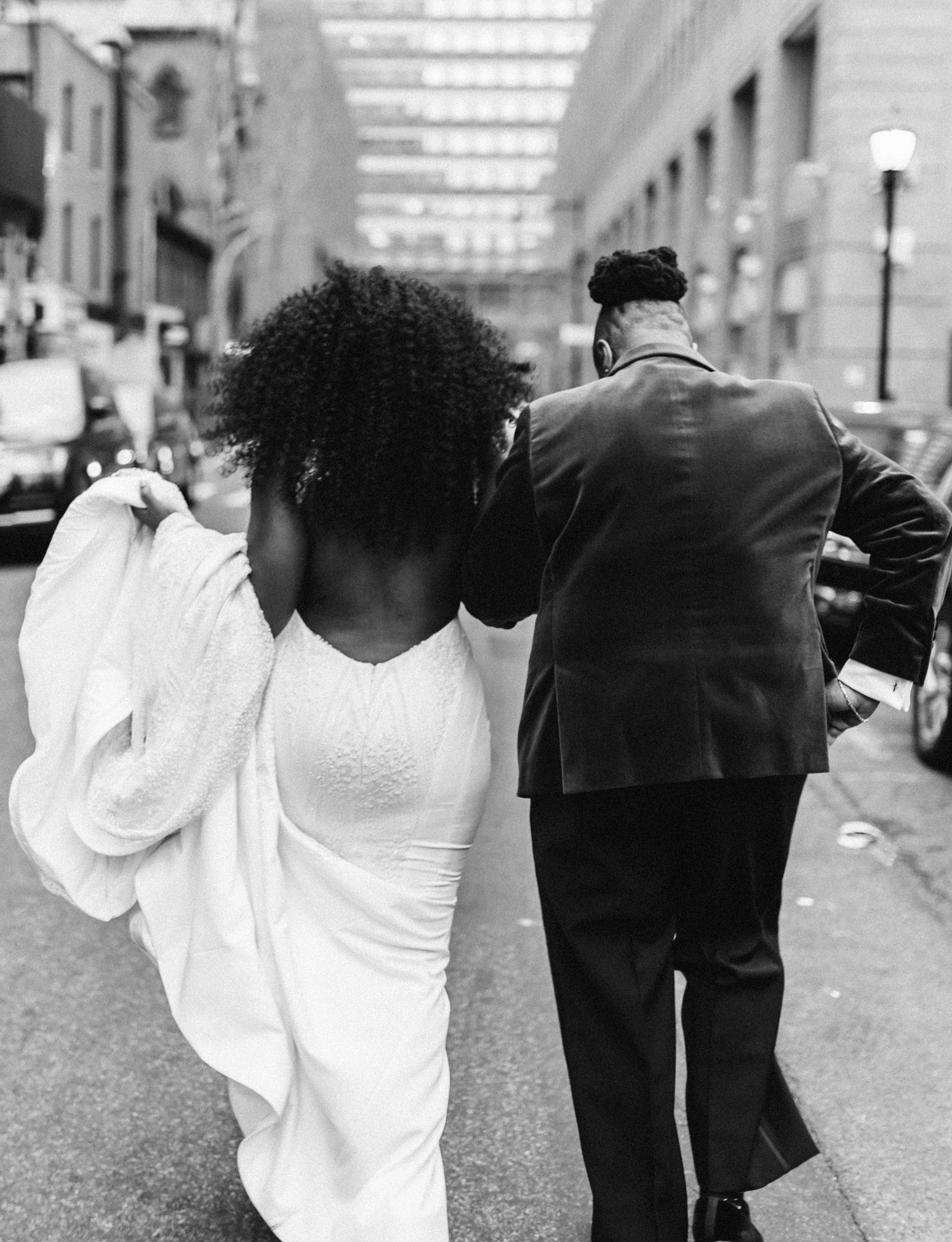 A black lesbian wedding couple walk the streets of New York city together before their Brooklyn Winery wedding ceremony