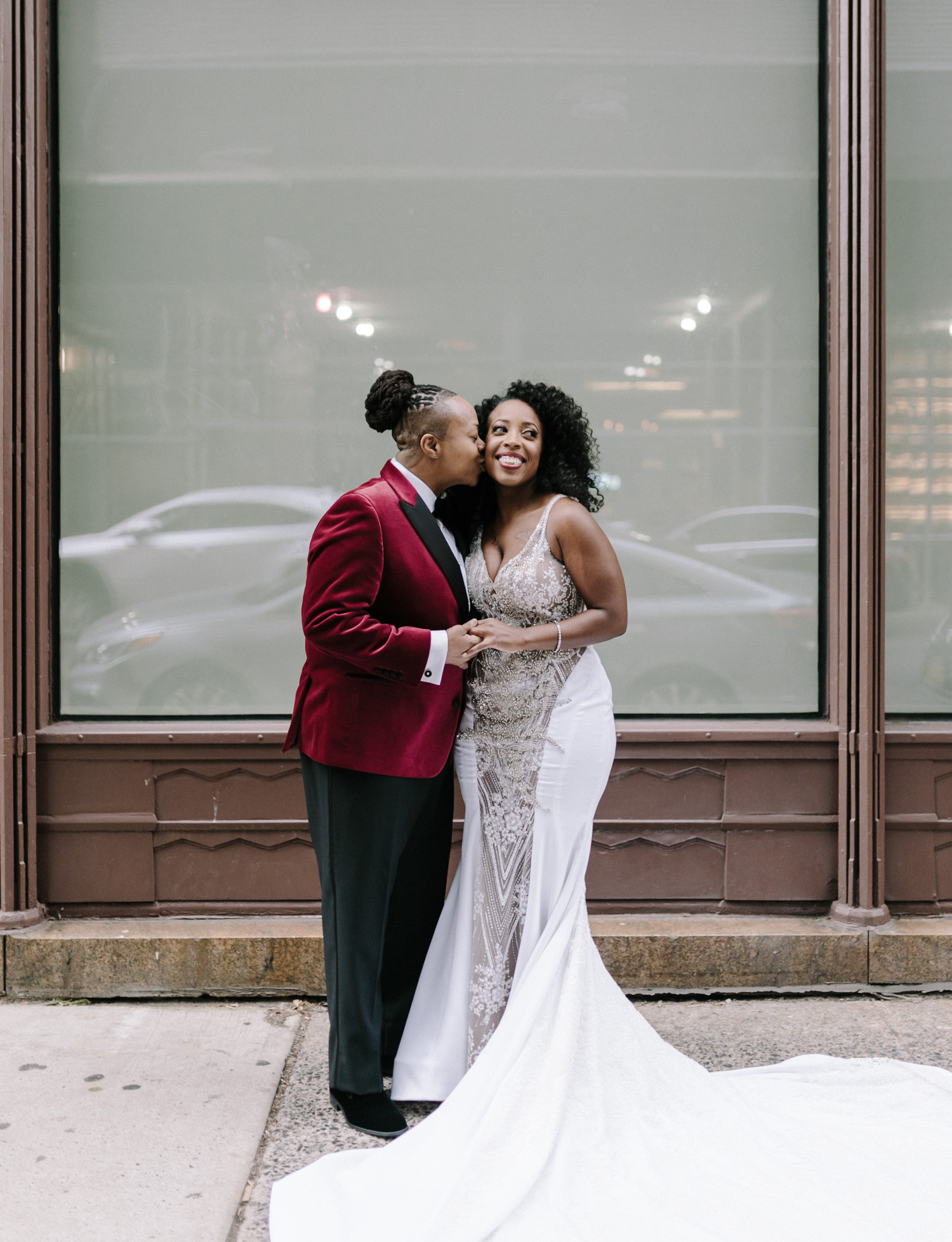 A black lesbian wedding couple embrace in Brooklyn, New York before their Brooklyn Winery wedding