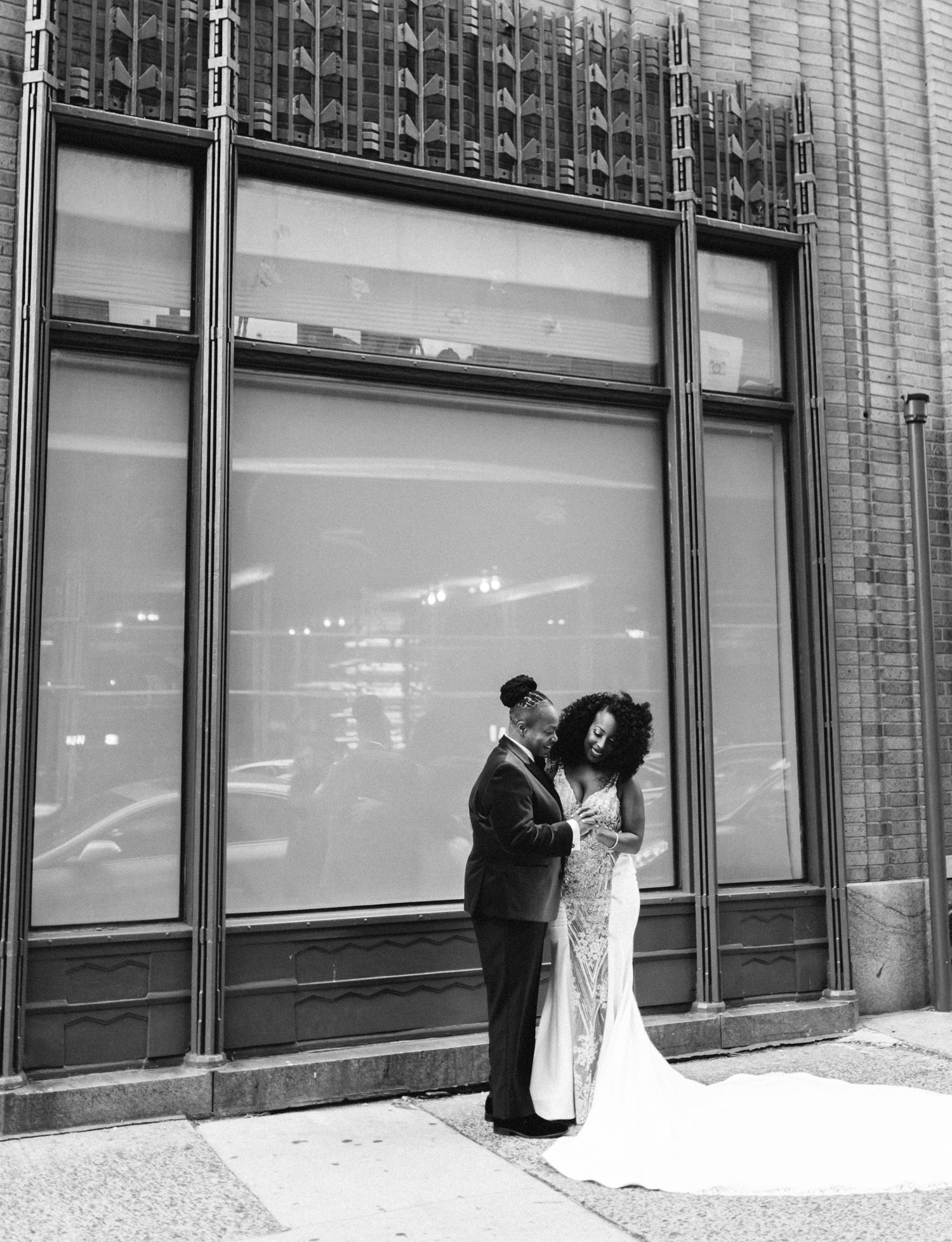 A black same sex wedding couple explores the streets of New York City before their winter wedding ceremony at Brooklyn Winery
