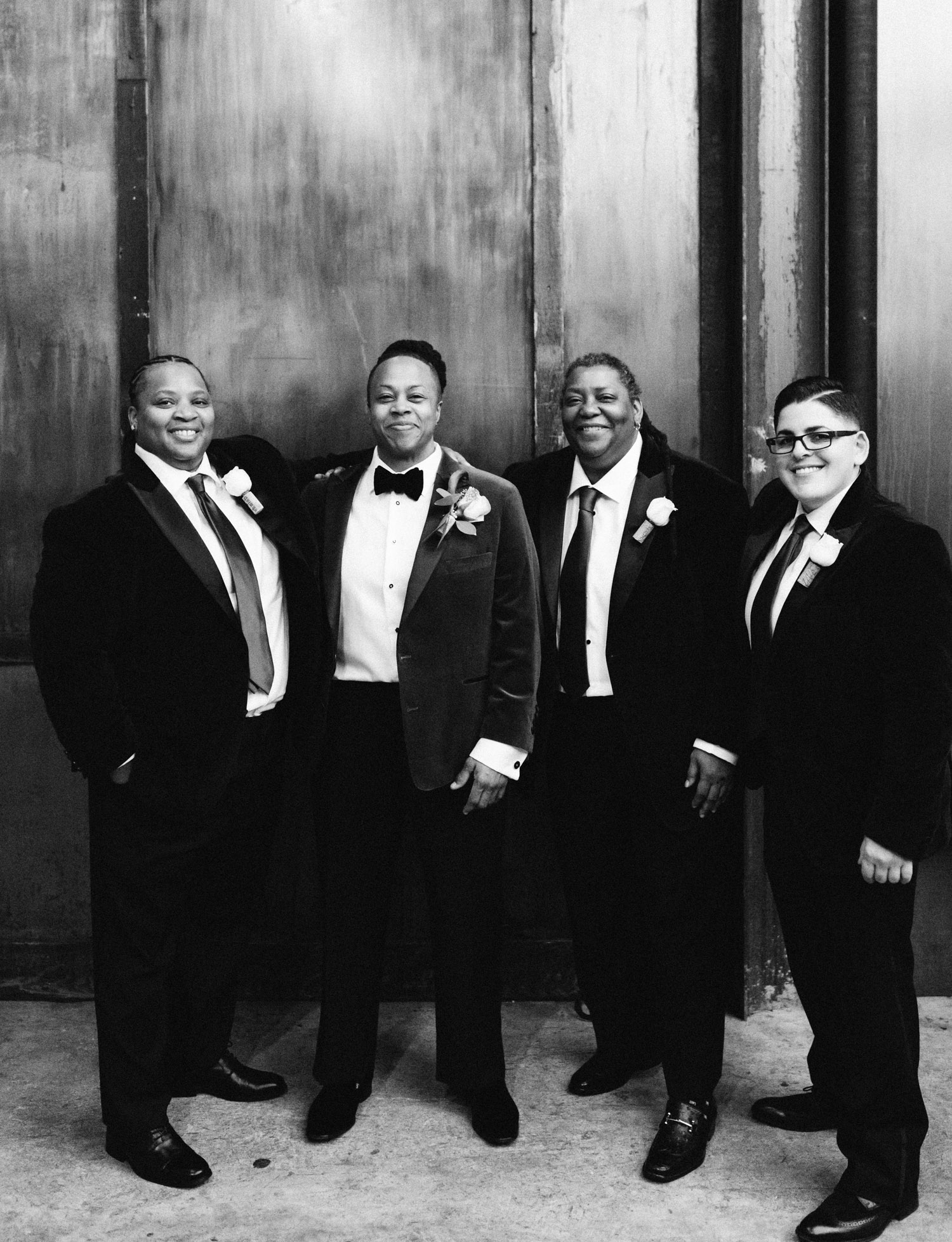 A wedding party poses together during a black same sex wedding at Brooklyn Winery in New York City