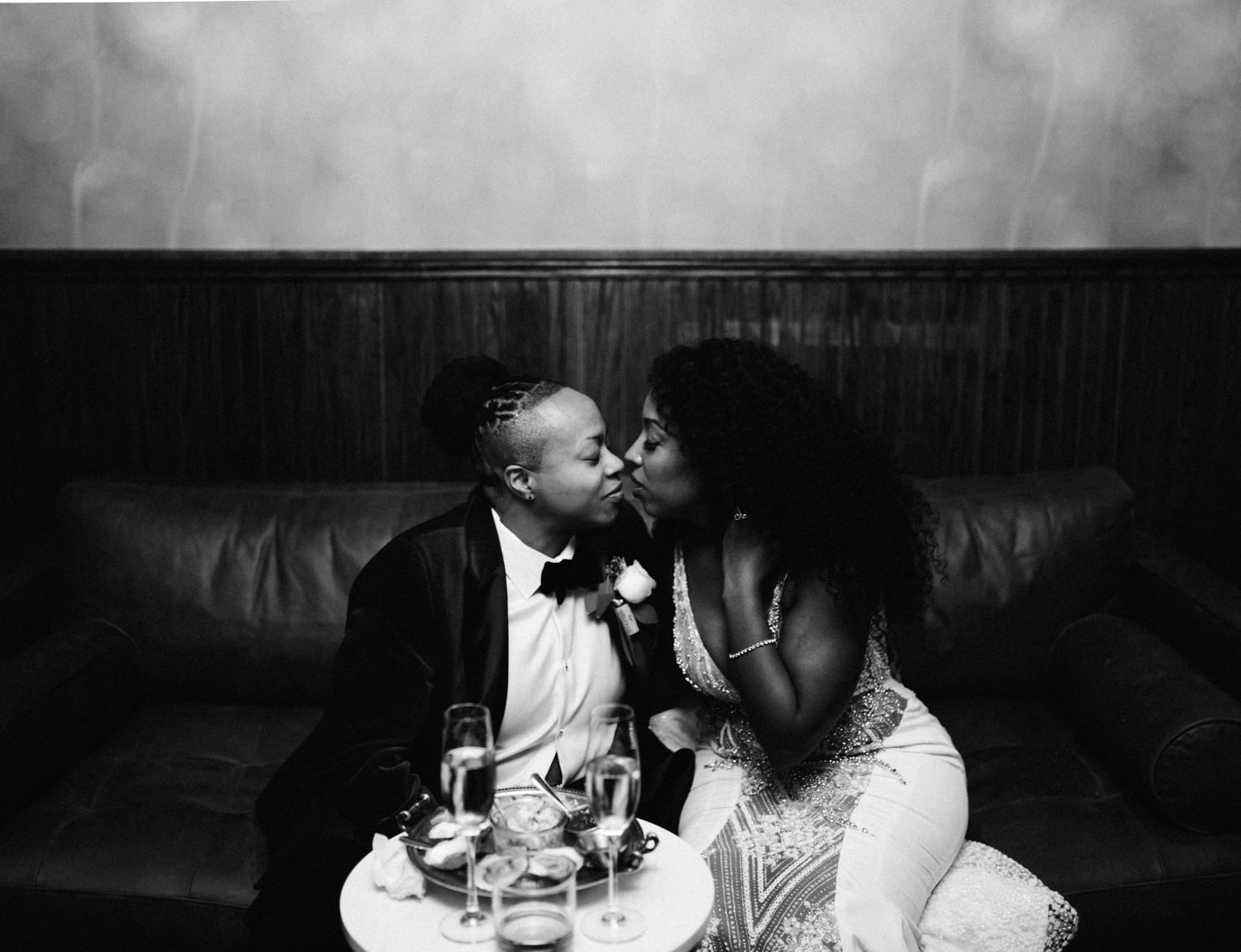 A black lesbian wedding couple hides away for a quiet moment during their reception at Brooklyn Winery in New York