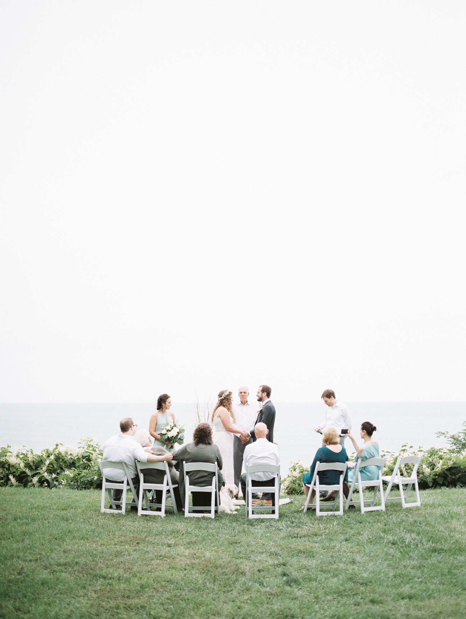 A small, intimate wedding ceremony overlooking Lake Michigan