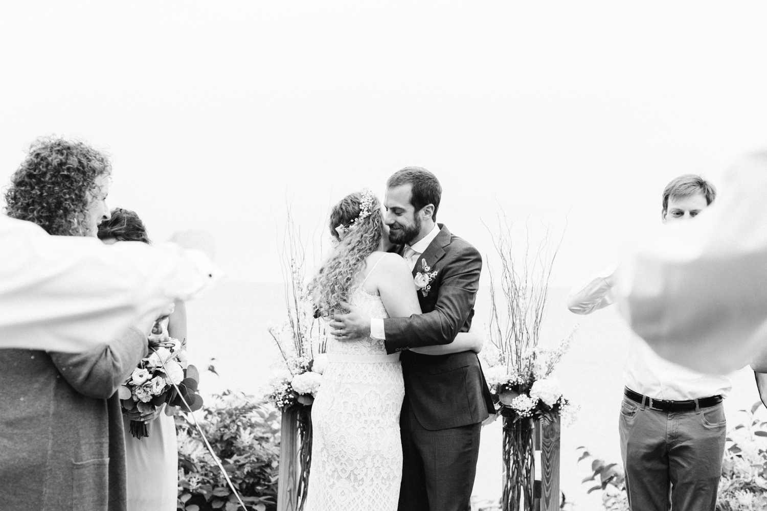 A bride and groom embrace after being pronounced husband and wife