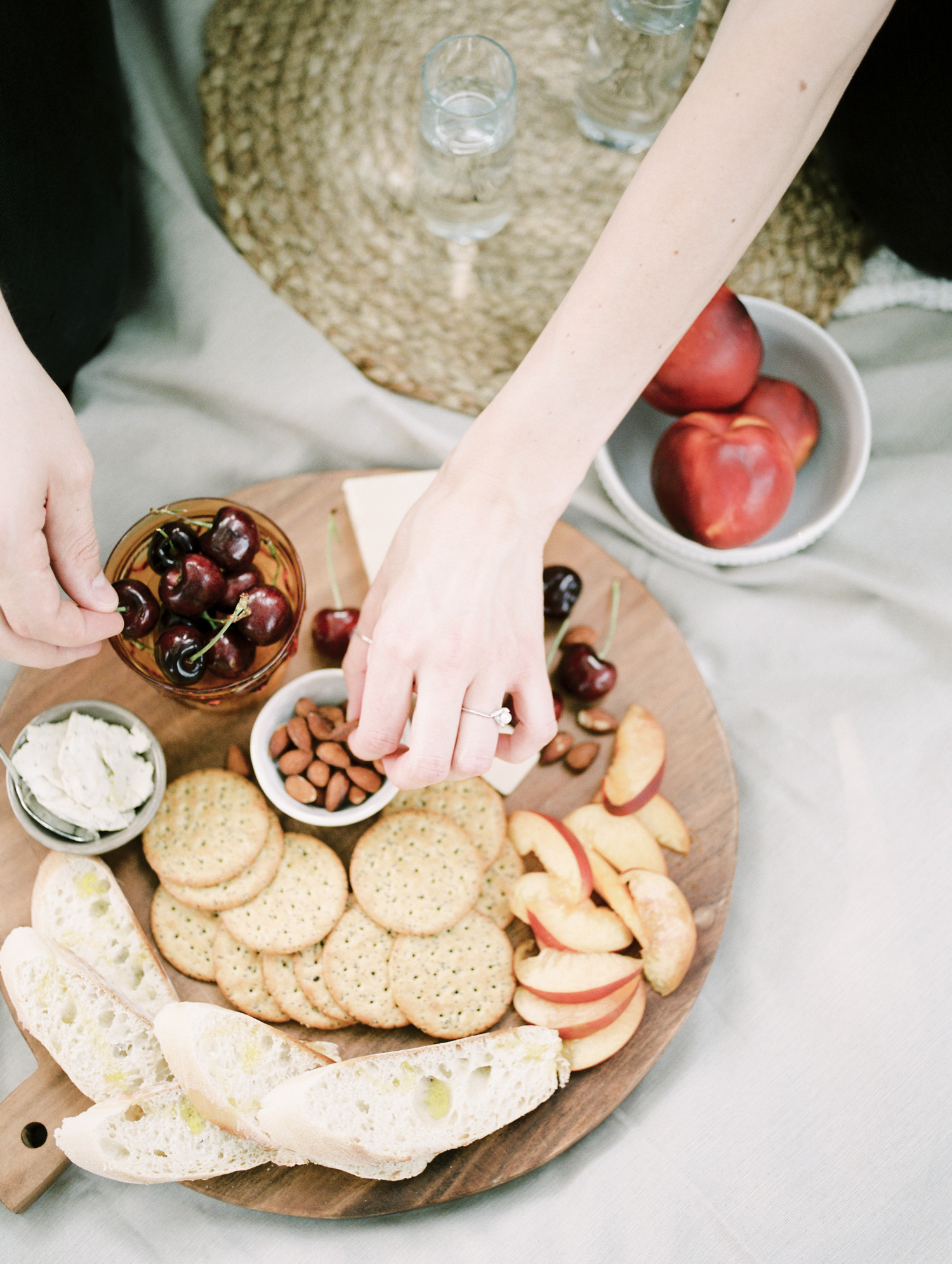 A Detroit couple shares cherries, almonds, vegan cheese, and seasonal fruit during their at home couple photos in Rochester, Michigan