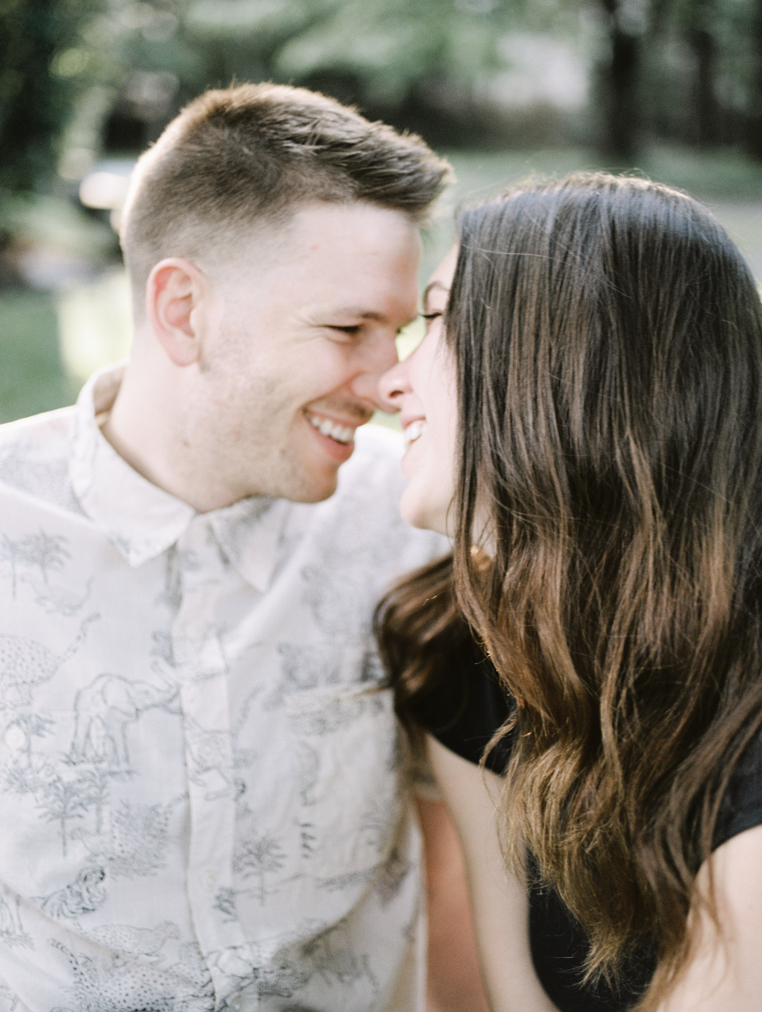 A Detroit couple shares a laugh together in a close up photo during their at home session