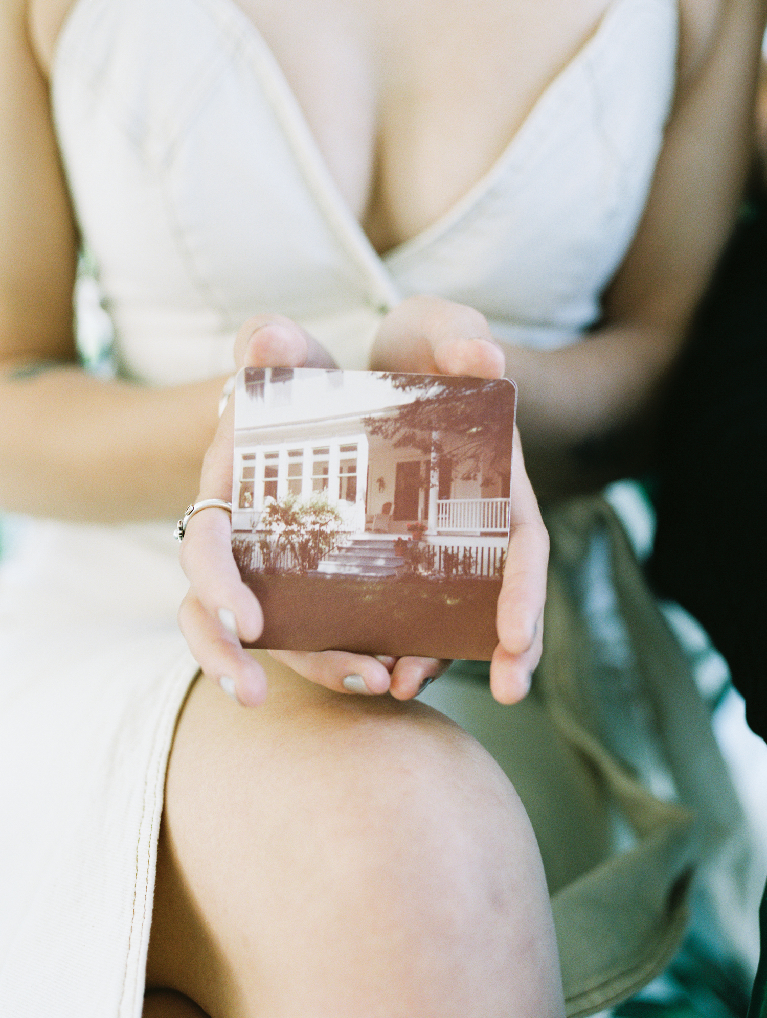 A woman holds an old photograph of her family's summer home in Petoskey, Michigan