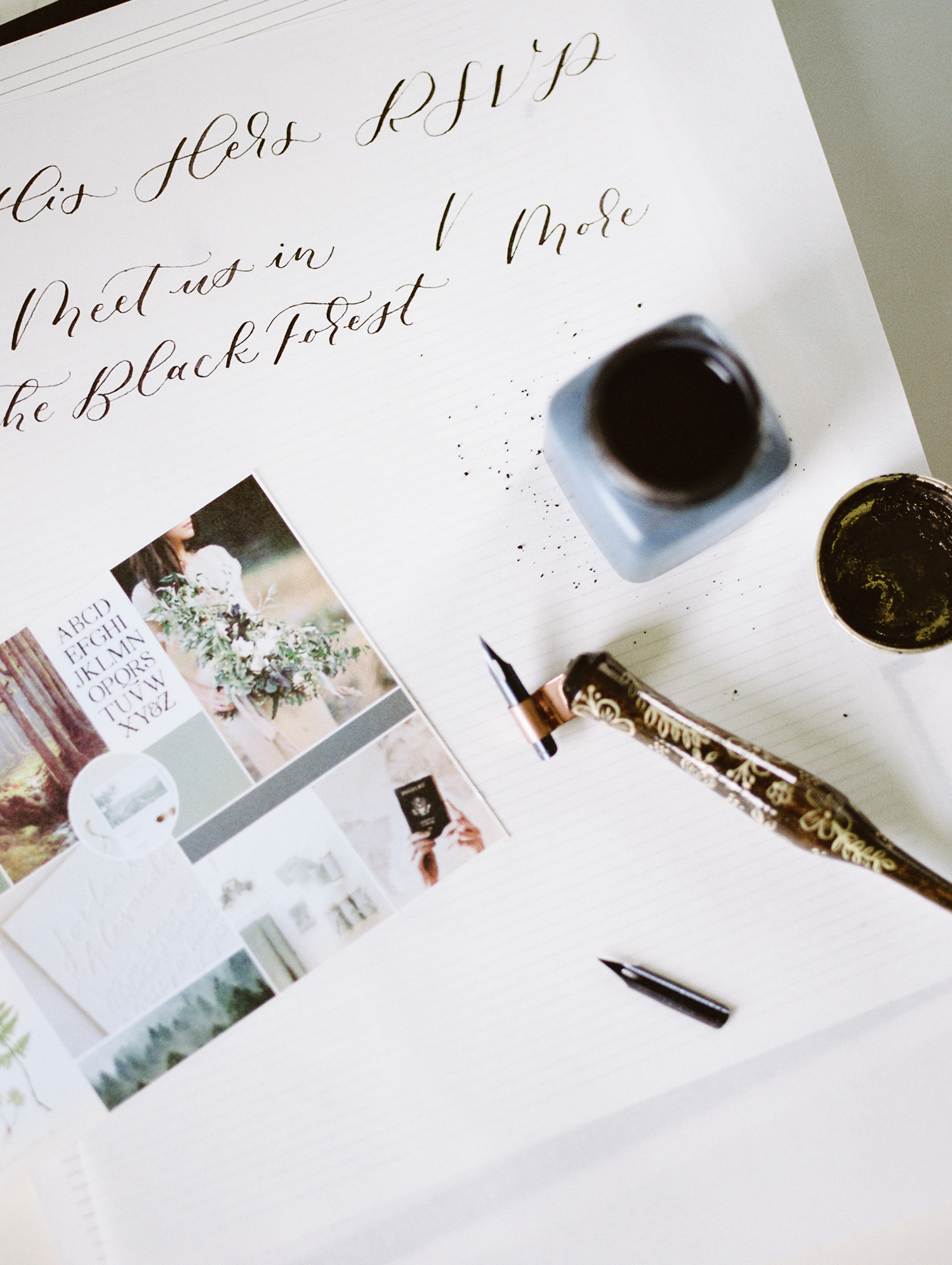 calligraphy ink and pen rest on a desk during a brand photo shoot in Detroit, Michigan