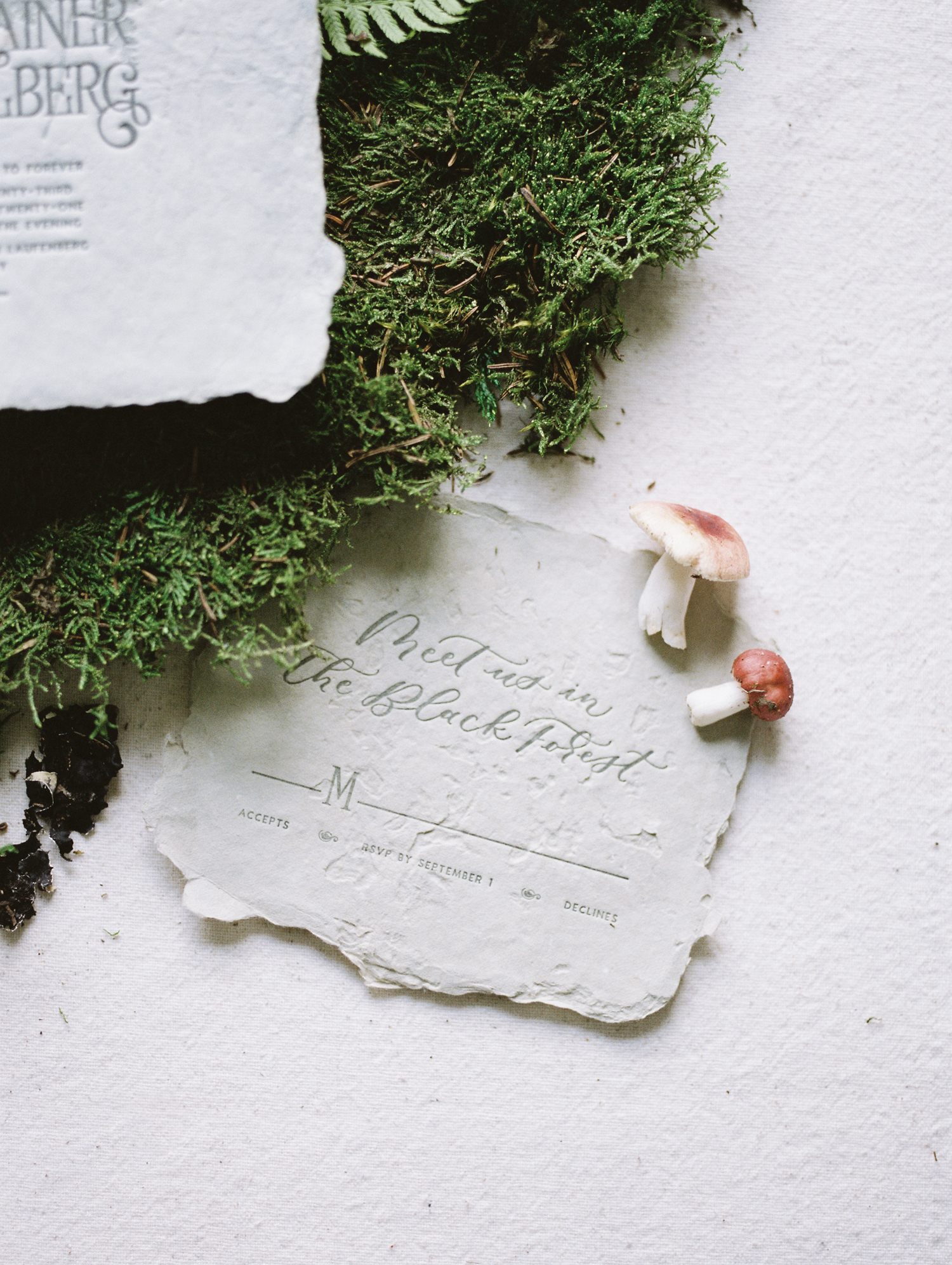 Custom wedding stationery on handmade paper created by Paper and Honey during her film brand photography session