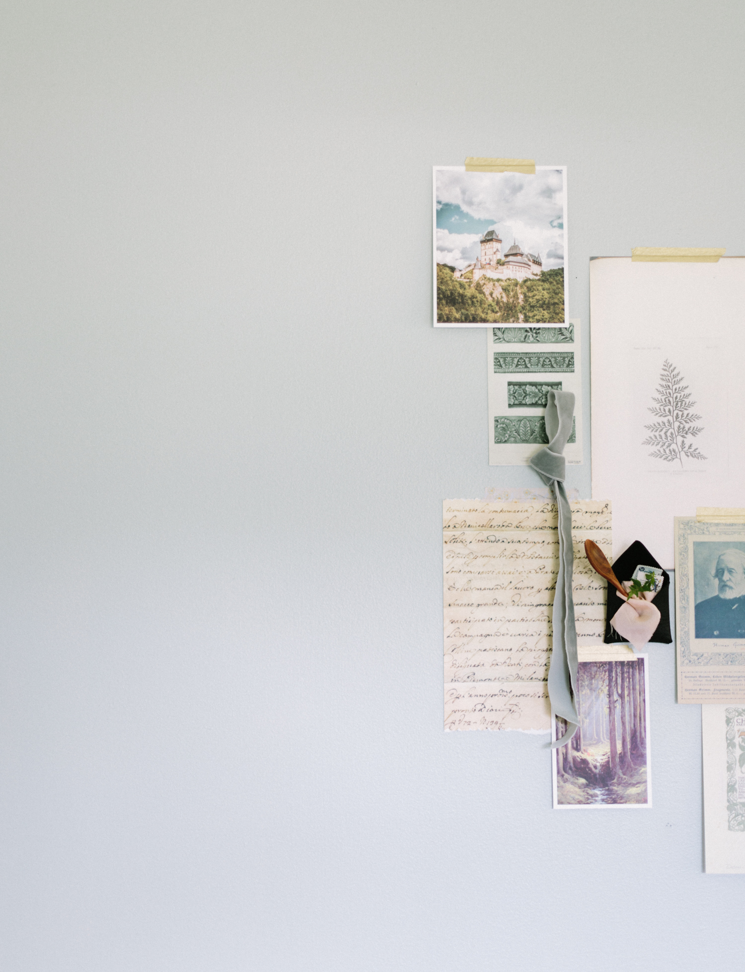 Inspiration for a forest themed stationery suite is pinned to a wall during a brand shoot for Paper and Honey in Michigan