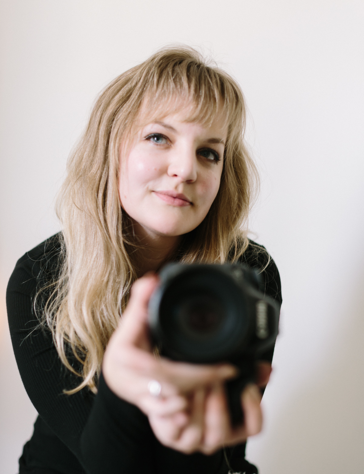 A Detroit, destination, and northern Michigan film wedding photographer captures a photo of herself in a mirror