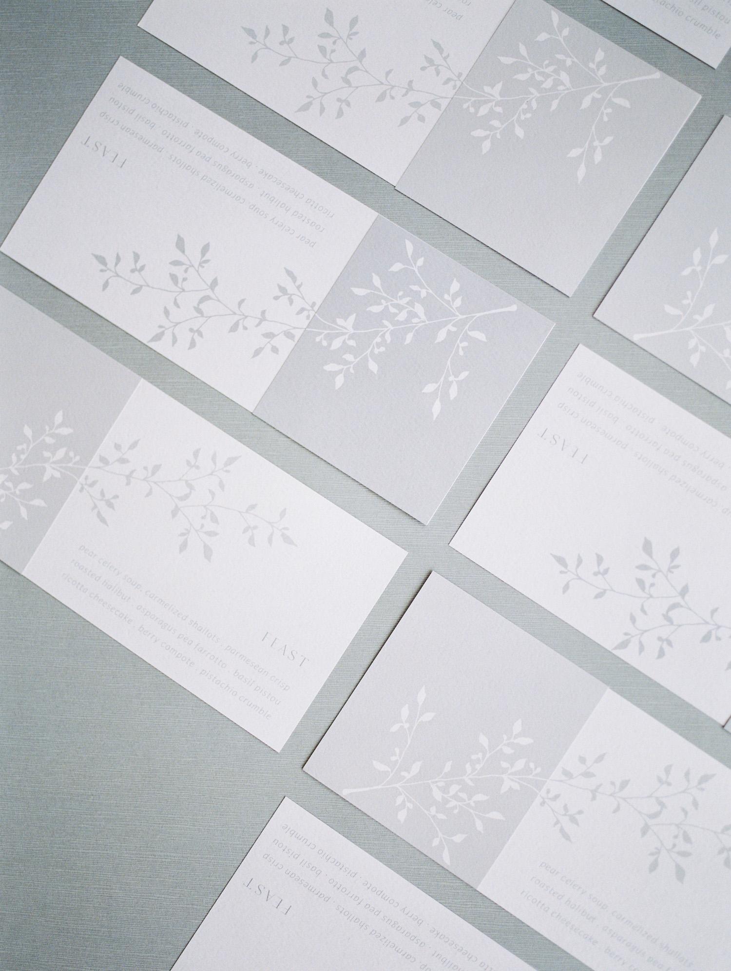 Grey wedding menus with a vine design by Erin Braun Design captured during her brand photoshoot in Michigan