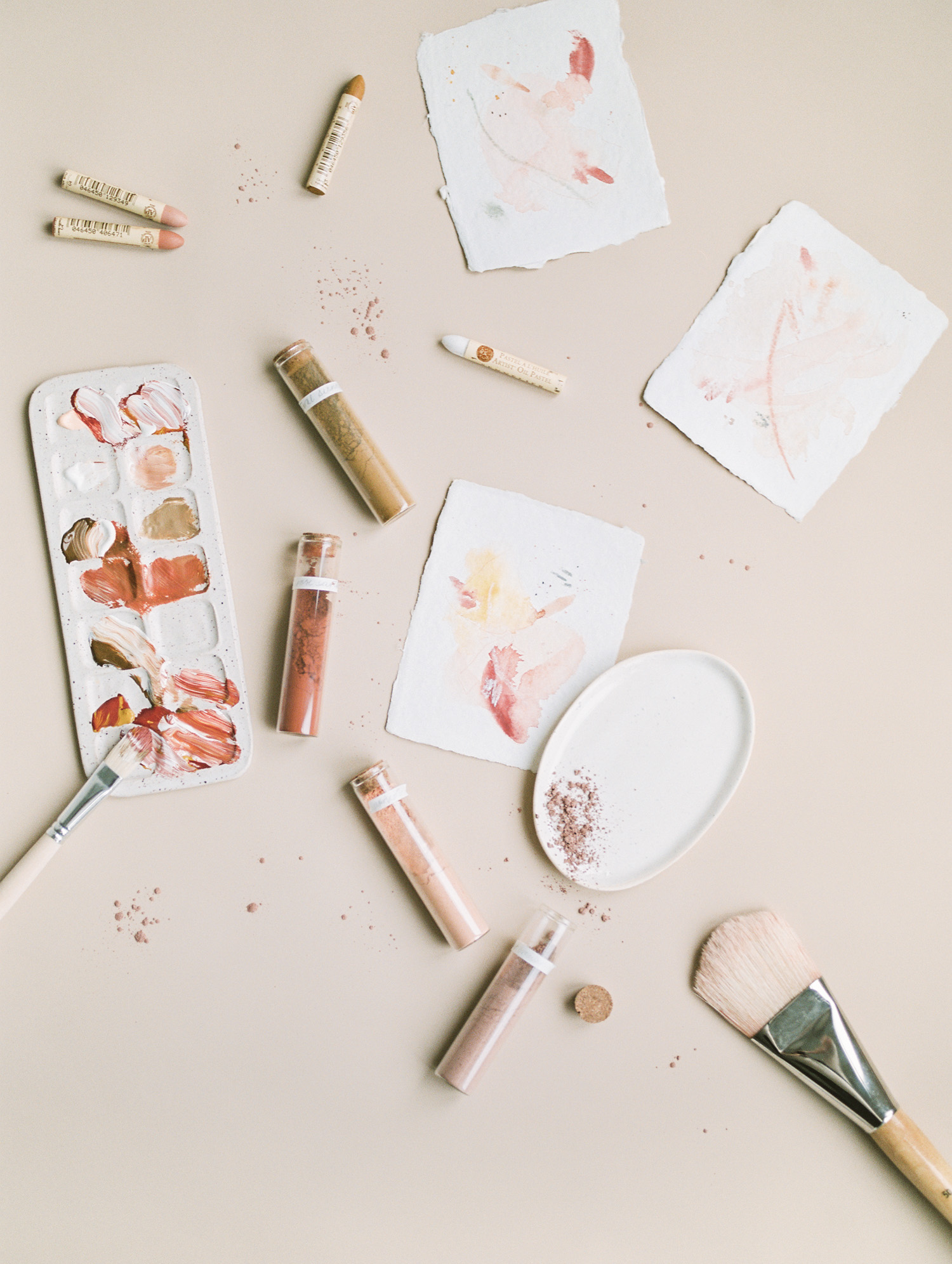 an artist aesthetic flat lay brand photo with paint pigments, palette, and brush in Detroit, Michigan