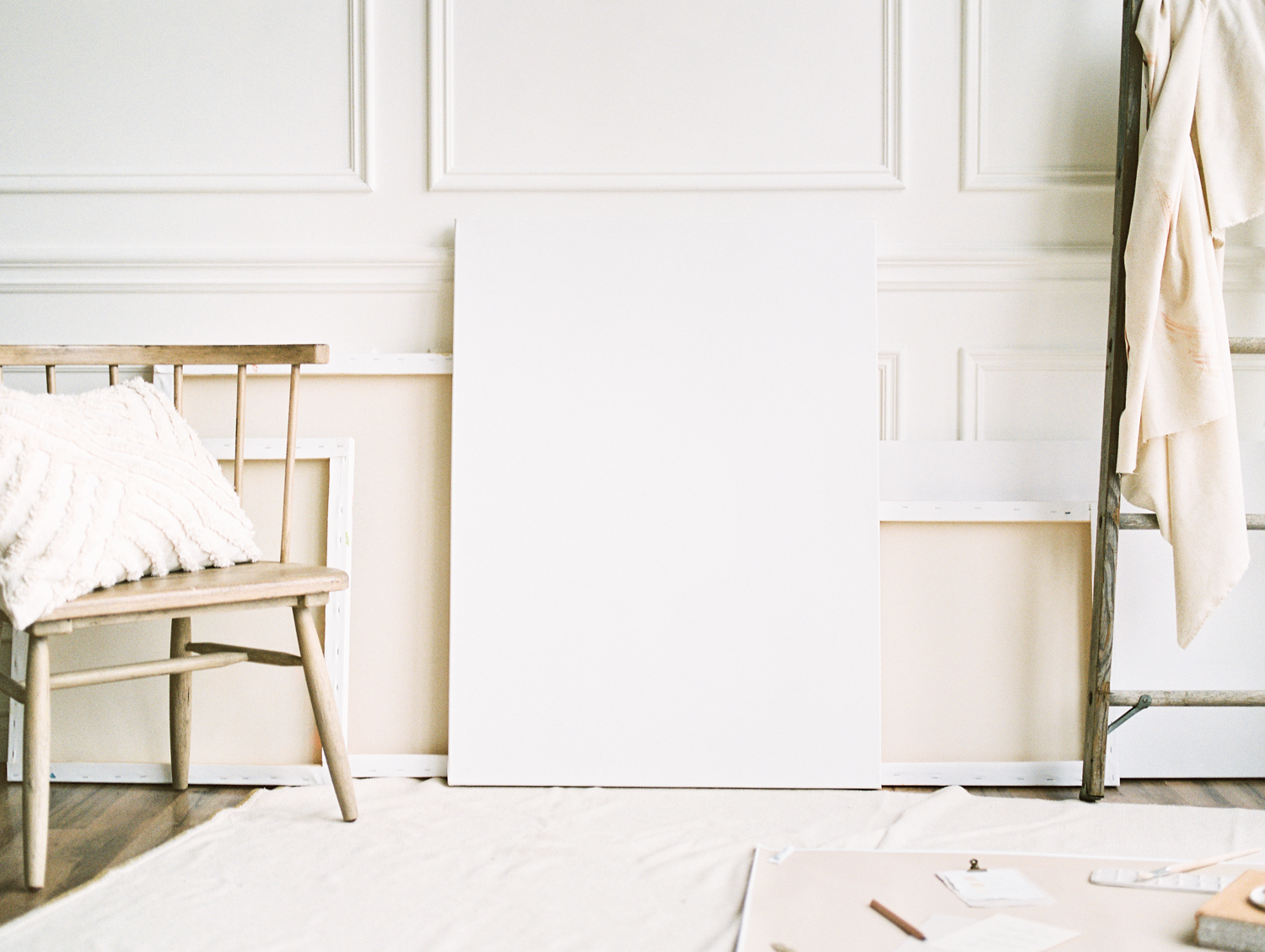 A white art studio space in Detroit, Michigan with a painter aesthetic captured by Michigan brand photographer Christina Harrison