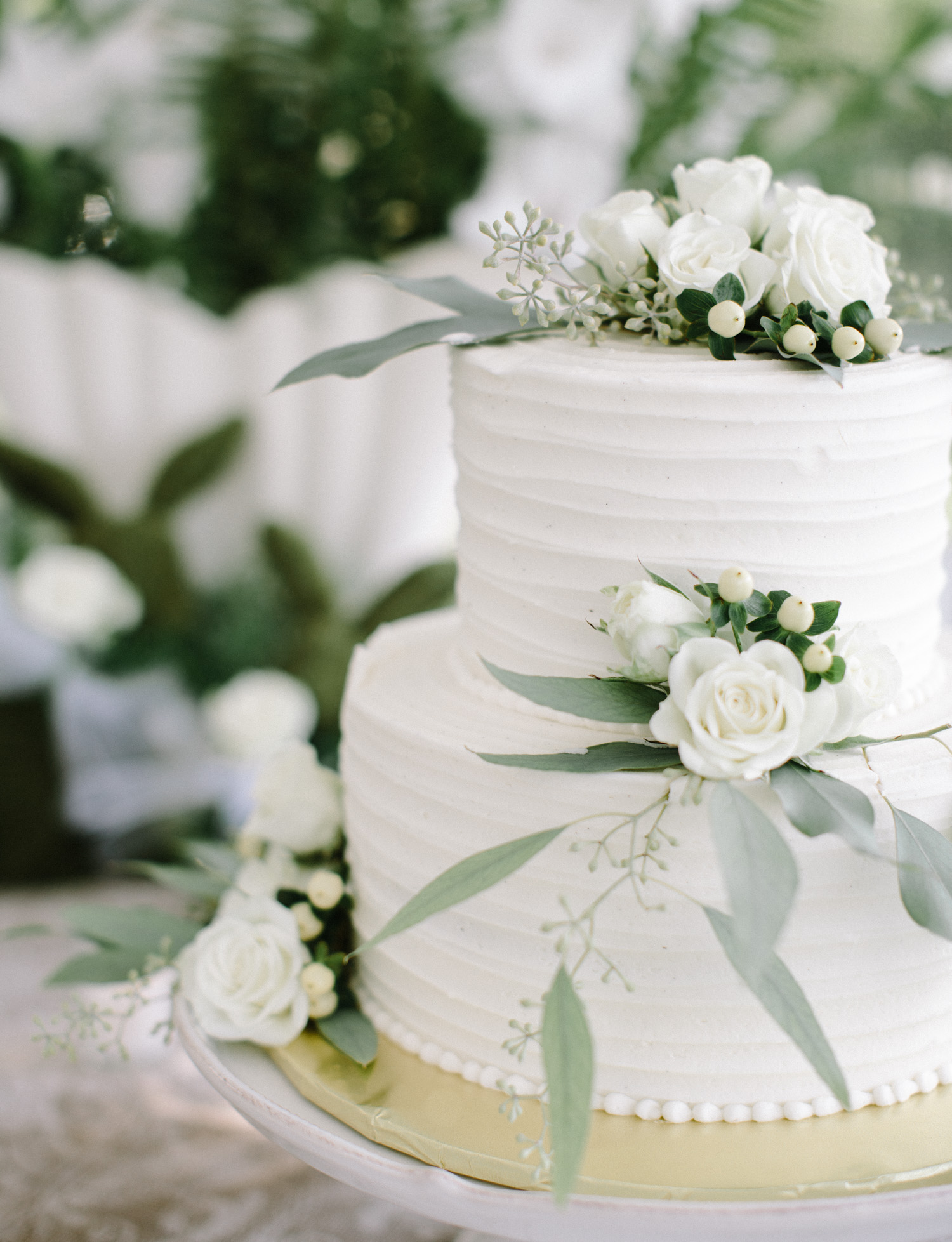 a vanilla bean wedding cake with flowers and greenery in Petoskey, Michigan